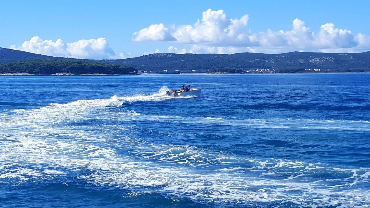 Blue Sea Nautical Vessel Horizontal Outdoors Water Sky Sunny Catamaran Cityscape Idyllic Sailing Ship Yacht Wave Motion Aquatic Sport Sailboat Yachting Sailing Real People