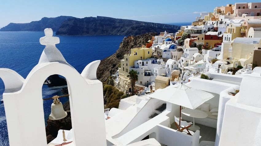 Architecture Built Structure Building Exterior Sea Water Clear Sky Mountain Outdoors Day Santorini Nature Scenics Tranquil Scene Town Tranquility Mountain Range No People Residential District Waterfront Beauty In Nature
