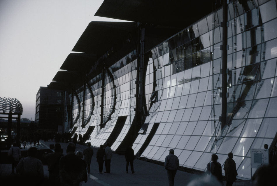 Analogue Photography Architecture Building Exterior Built Structure City City Life Composition Crowd Expo2000 Famous Place Glass - Material Group Of People Large Group Of People Leisure Activity Lifestyles Modern Person Walking