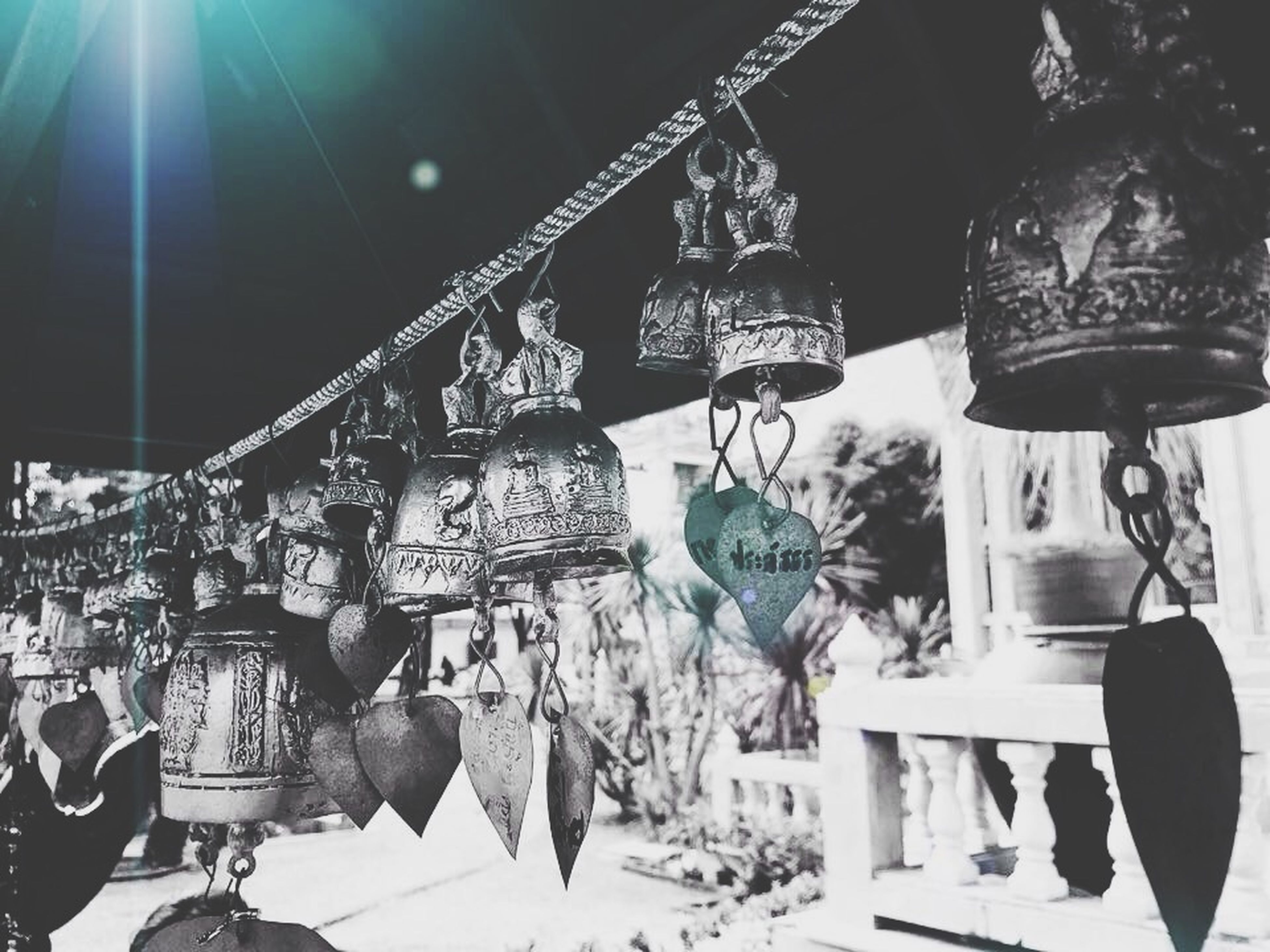lighting equipment, hanging, architecture, built structure, lantern, illuminated, low angle view, decoration, ceiling, building exterior, electric lamp, indoors, lamp, street light, sunlight, electric light, electricity, potted plant, in a row, men