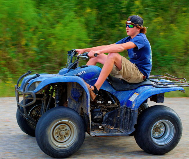 Boy ridding a 4 wheeler 4wd Boy Casual Clothing Having Fun Having Fun :) Speeding Yamaha