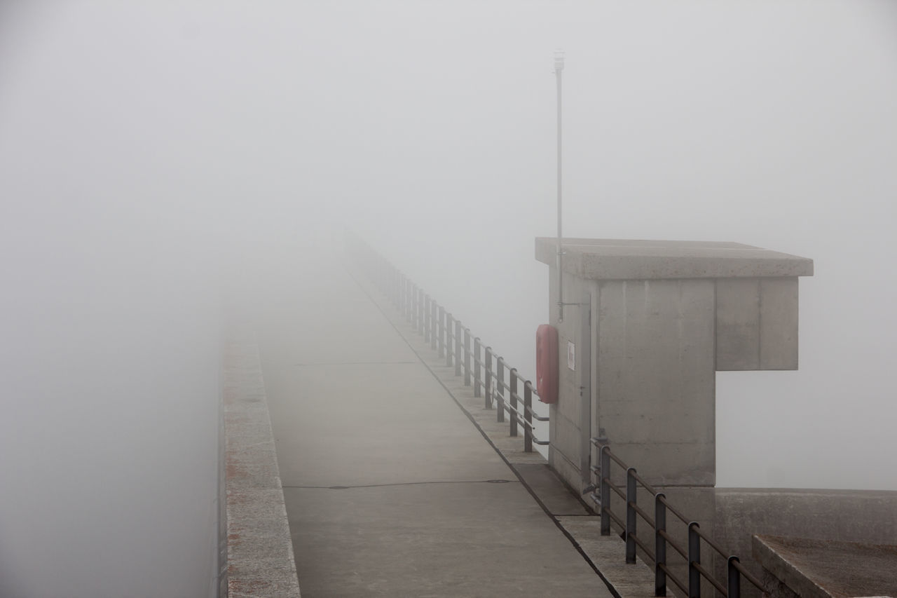 Dam at Räterichsbodensee with clouds rolling up Grimsel Valley, Berner Oberland, Switzerland Architecture Background Disappearing Clouds Clouds Rolling In Dam Fog Grey Grey Day Leading Lines Masonry No People Poor Visibility Rescue Station Structures & Lines Visibility Wall