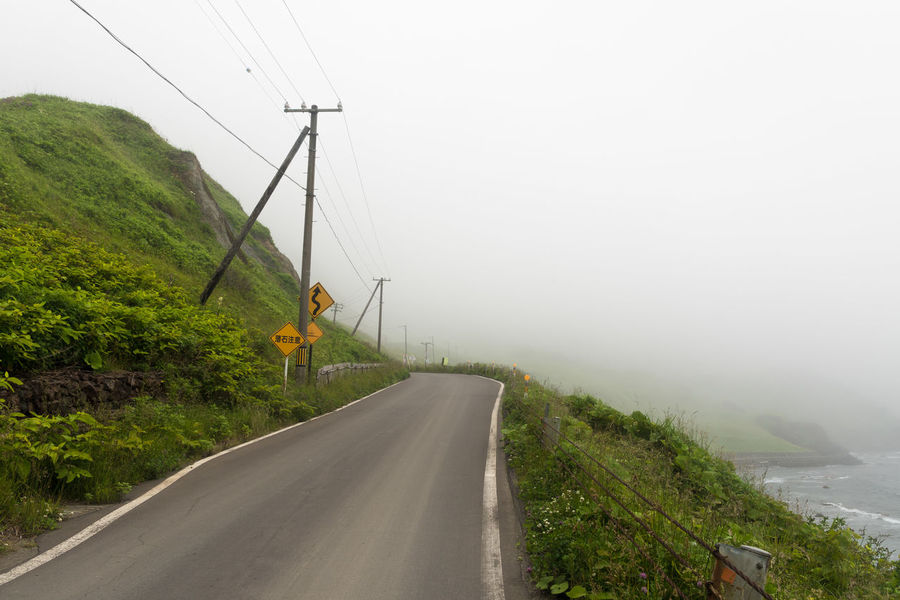 EyeEm Selects Landscape Road Fog Rural Scene Outdoors Day No People Agriculture Social Issues Field Electricity  Fuel And Power Generation Cable Nature Electricity Pylon Sky Beauty In Nature Telephone Line Irrigation Equipment Rebun Island Hokkaido Japan