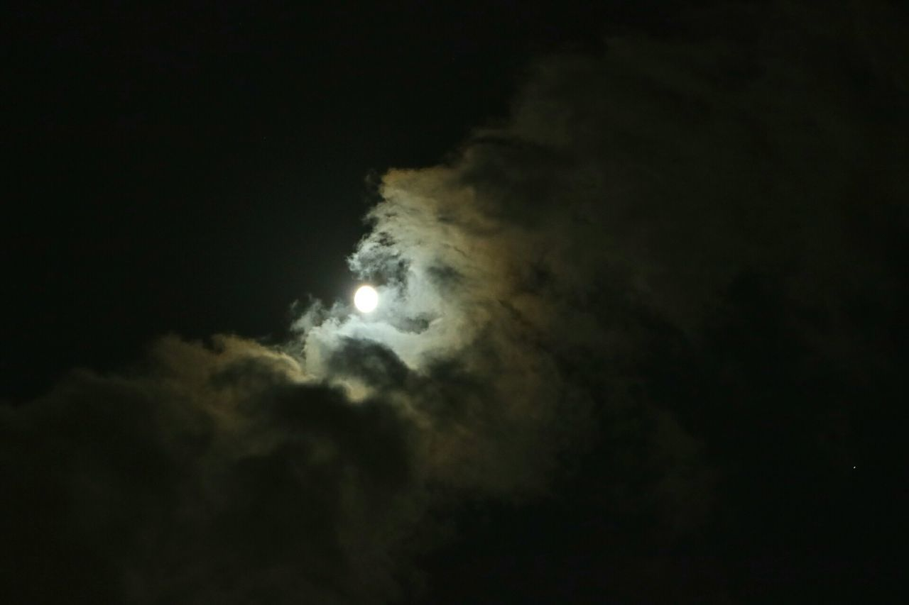 moon, night, astronomy, sky, nature, scenics, low angle view, beauty in nature, dark, space exploration, tranquility, natural phenomenon, cloud - sky, outdoors, solar eclipse, tranquil scene, moonlight, sky only, no people, space, half moon, crescent