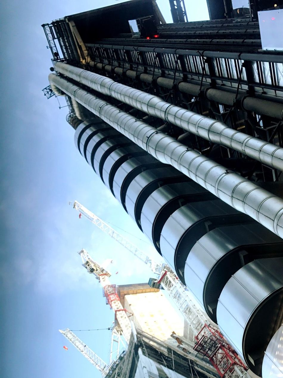 Lloyds Building Richard Roger Skyscraper Building As Machine Stairs Architecture Built Structure Building Exterior Low Angle View Sky Airplane No People Travel Destinations City Day Air Vehicle Outdoors