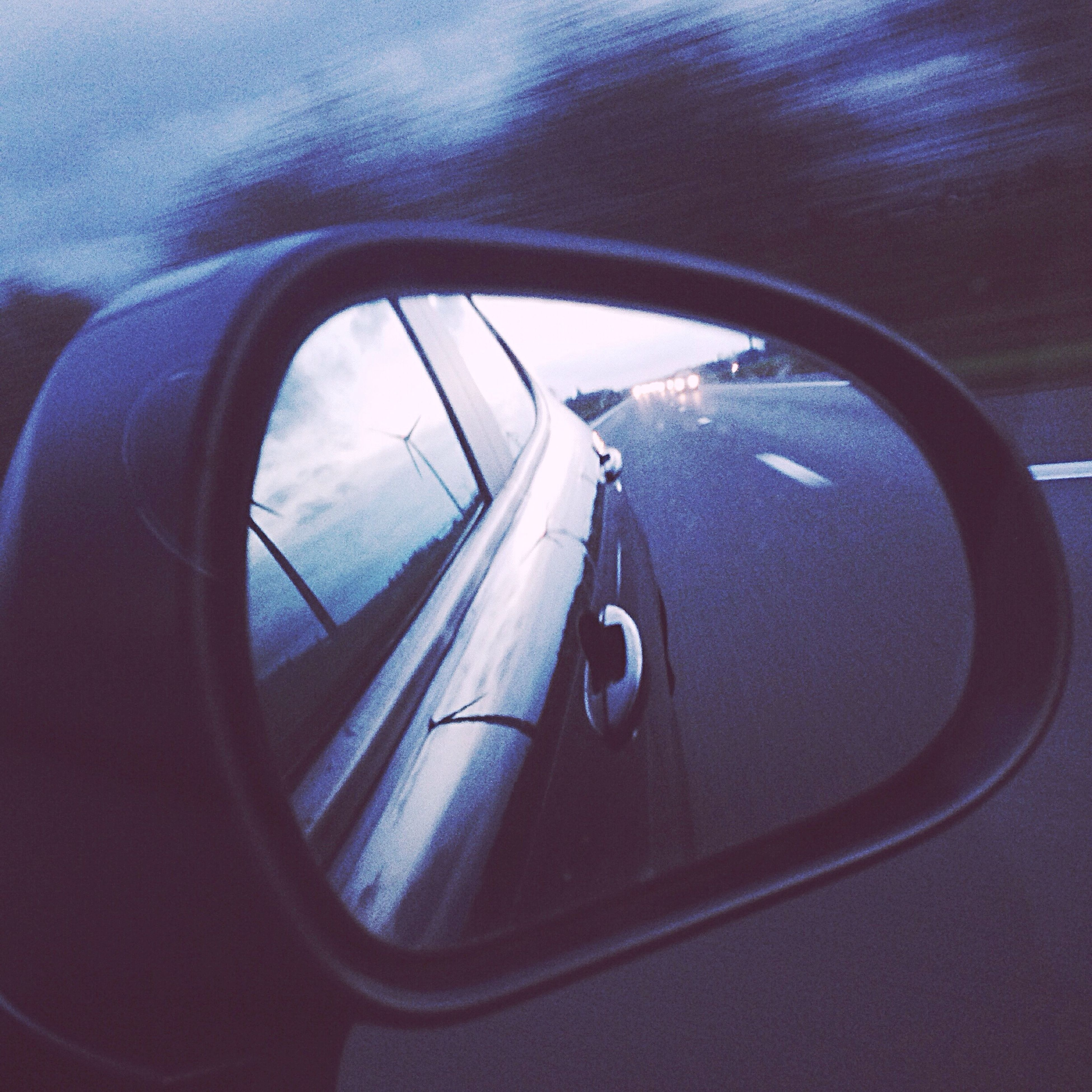 transportation, mode of transport, land vehicle, car, vehicle interior, travel, side-view mirror, reflection, on the move, part of, journey, car interior, cropped, road, sky, glass - material, windshield, vehicle part, transparent, day