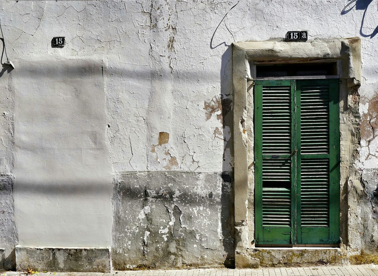Urban Poetry Dissolved Doors With Stories Door Number 15 Door Number 15A Light And Shadow No People Mallorcastyle SPAIN