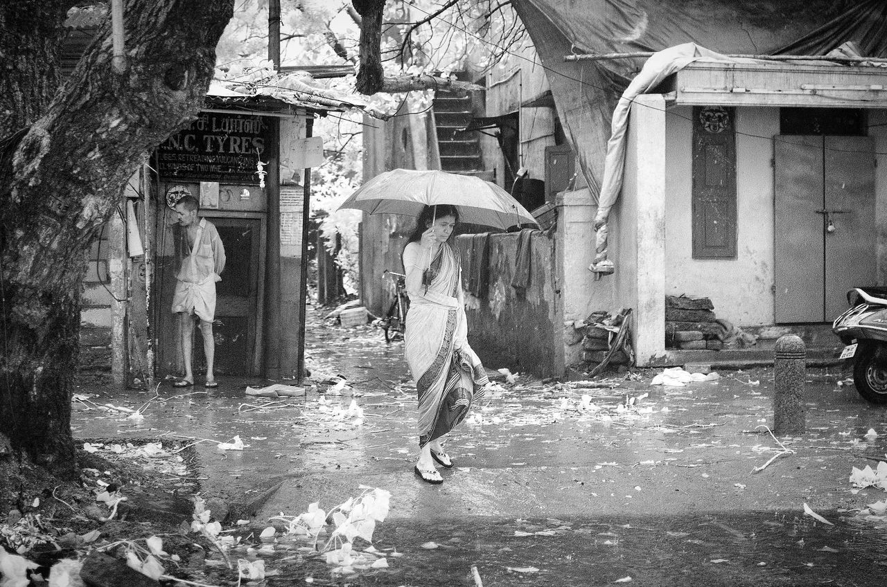 wet, real people, under, water, one person, below, full length, outdoors, shelter, men, day, lifestyles, built structure, tree, women, architecture, nature, adult, adults only, people