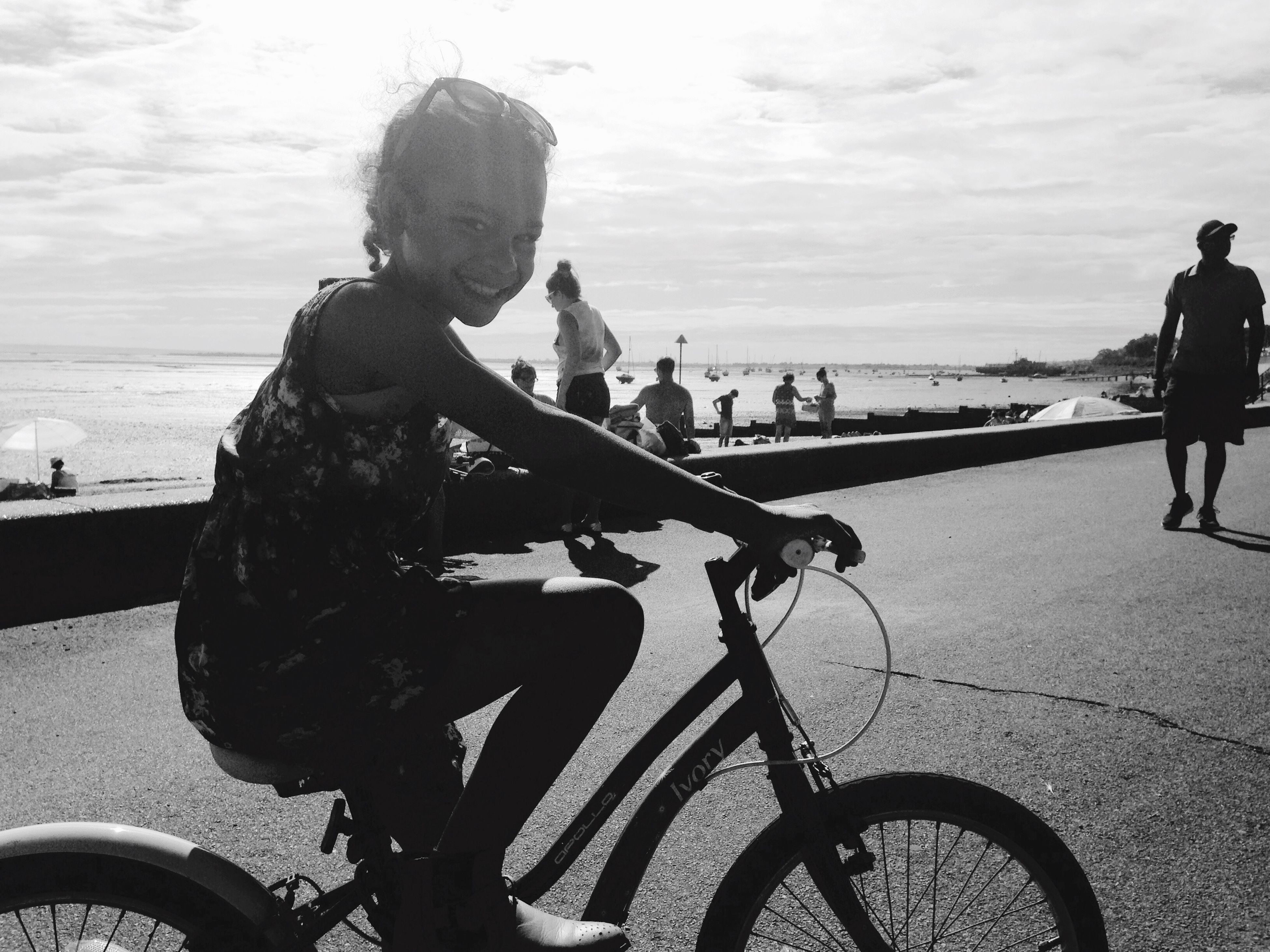 bicycle, sea, lifestyles, leisure activity, sky, men, beach, transportation, water, mode of transport, land vehicle, shore, full length, cloud - sky, person, railing, horizon over water, travel