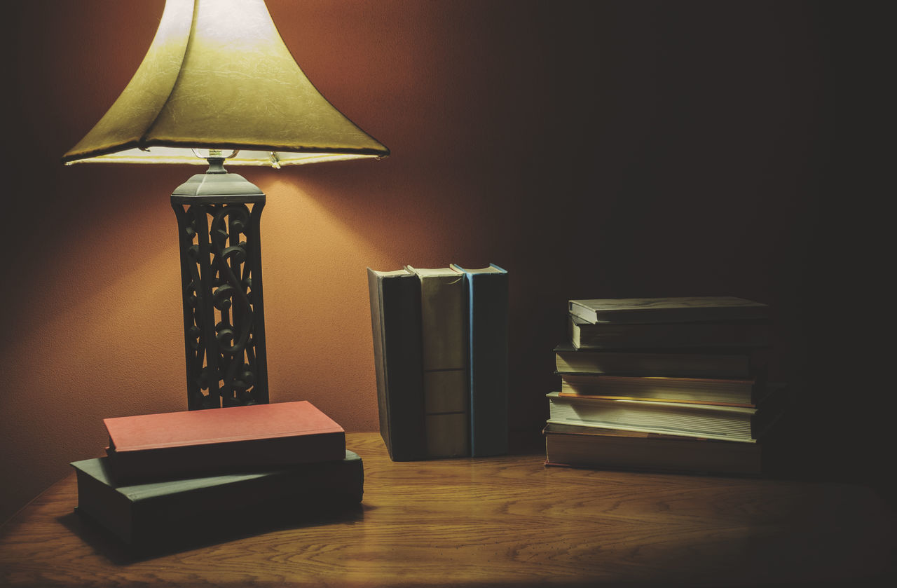 Book Education Electric Lamp Home Interior Home Showcase Interior Illuminated Indoors  Lamp Shade  Library Literature Low Light Photography No People Reading A Book Stack Table Wood