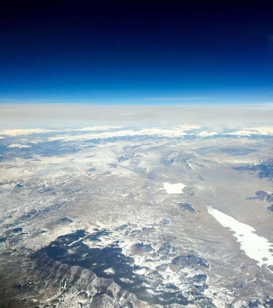 Flying over Colorado rocky mountainsThrough The Airplane Window Rocky Mountains Colorado Flying High Early Morning Blue Sky Unexploredparadise Landscape Beautiful Earth Unexplored Region Airplane View Magnificent World View From An Airplane Window From An Airplane Window Exotic View Flying High