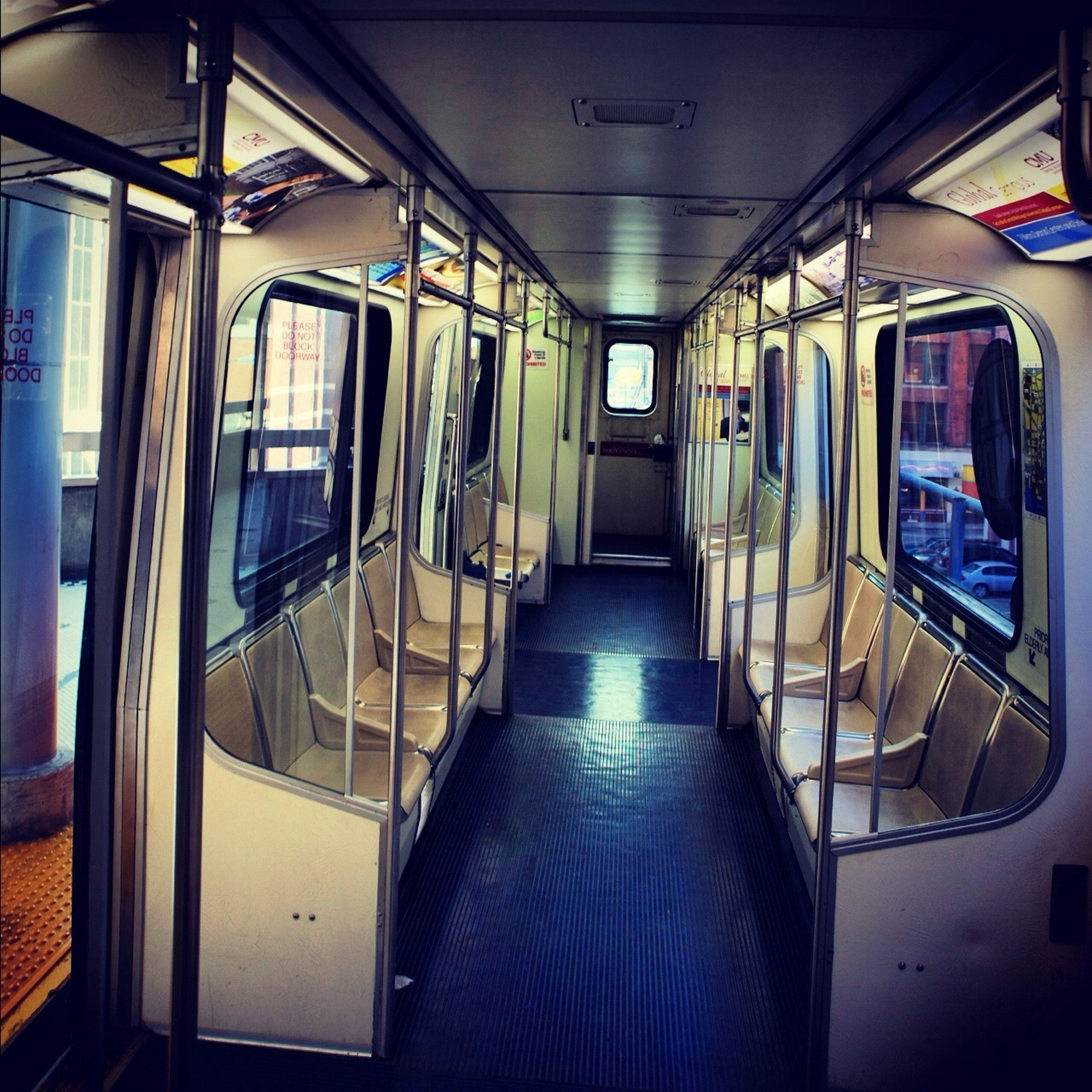 indoors, transportation, vehicle seat, window, public transportation, vehicle interior, mode of transport, interior, absence, passenger train, train - vehicle, reflection, escalator, rail transportation, travel, empty, glass - material, convenience, technology, train