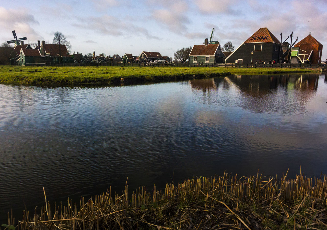 Just within a few meters are highways, wide streets and modern houses Beauty In Nature Country Dusk Lake Landscape Outdoors Reflection Rural Water Windmill Nikon 1  Neighborhood Map