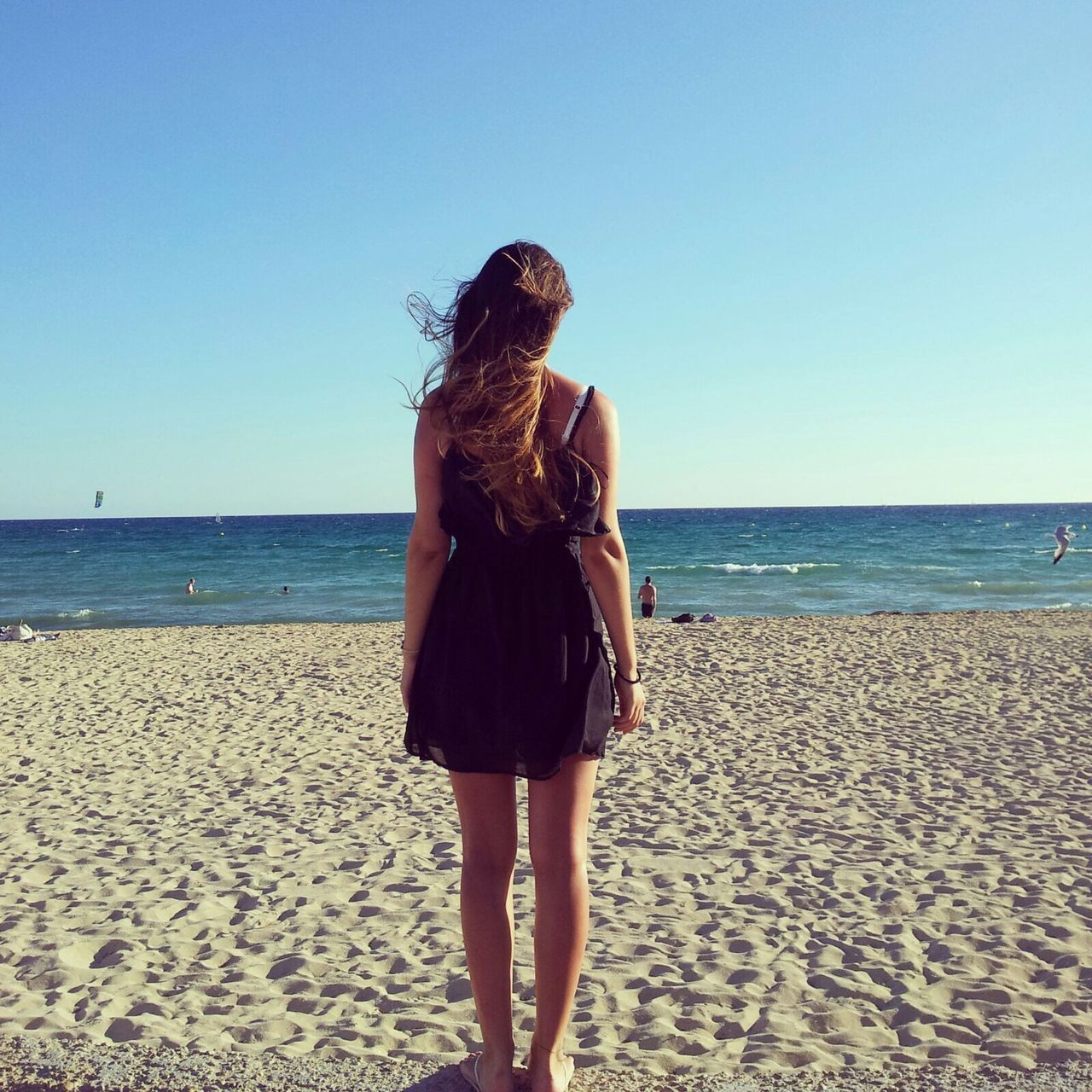 Peace of mind. Showcase March Summer Sea And Sky Horizon Over Water Horizon Girl Wind Sand Sandy Beach Beach Beautiful Waves Mallorca SPAIN Feel The Journey Beauty In Nature Clear Sky Colour Image Day Dress Long Hair Real People Rear View Relaxation Square Long Goodbye