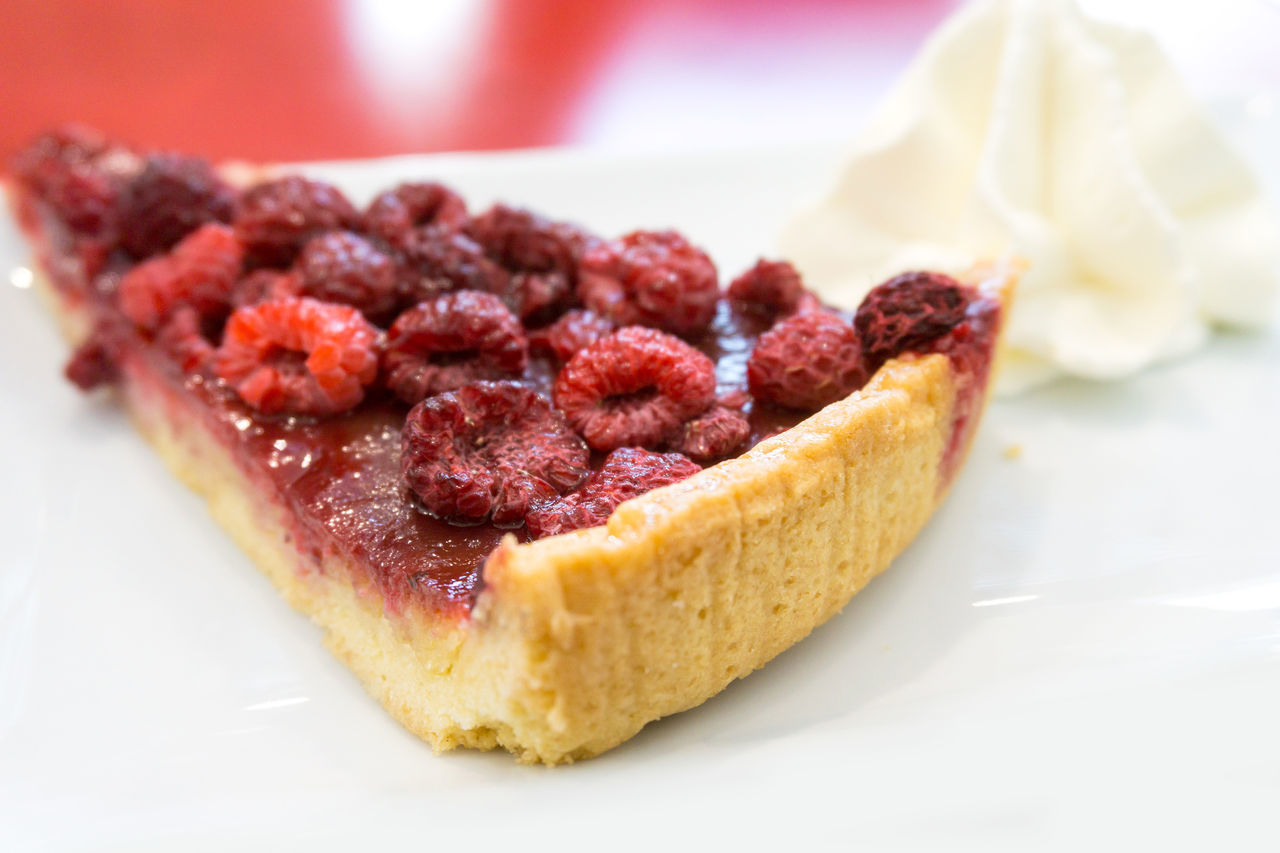 Close-Up Of Raspberry Pie With Cream In Plate