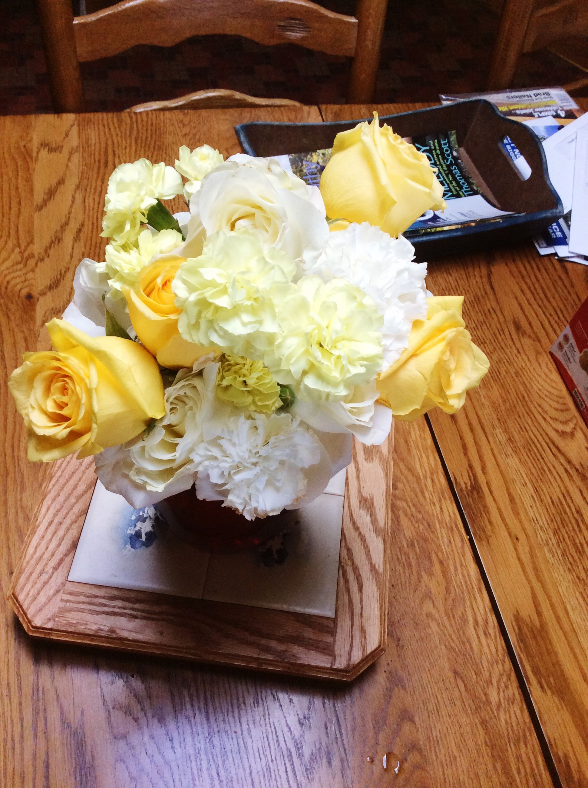indoors, flower, freshness, table, still life, wood - material, vase, yellow, high angle view, food and drink, food, petal, wooden, flower arrangement, no people, bouquet, close-up, fragility, flower head, rose - flower