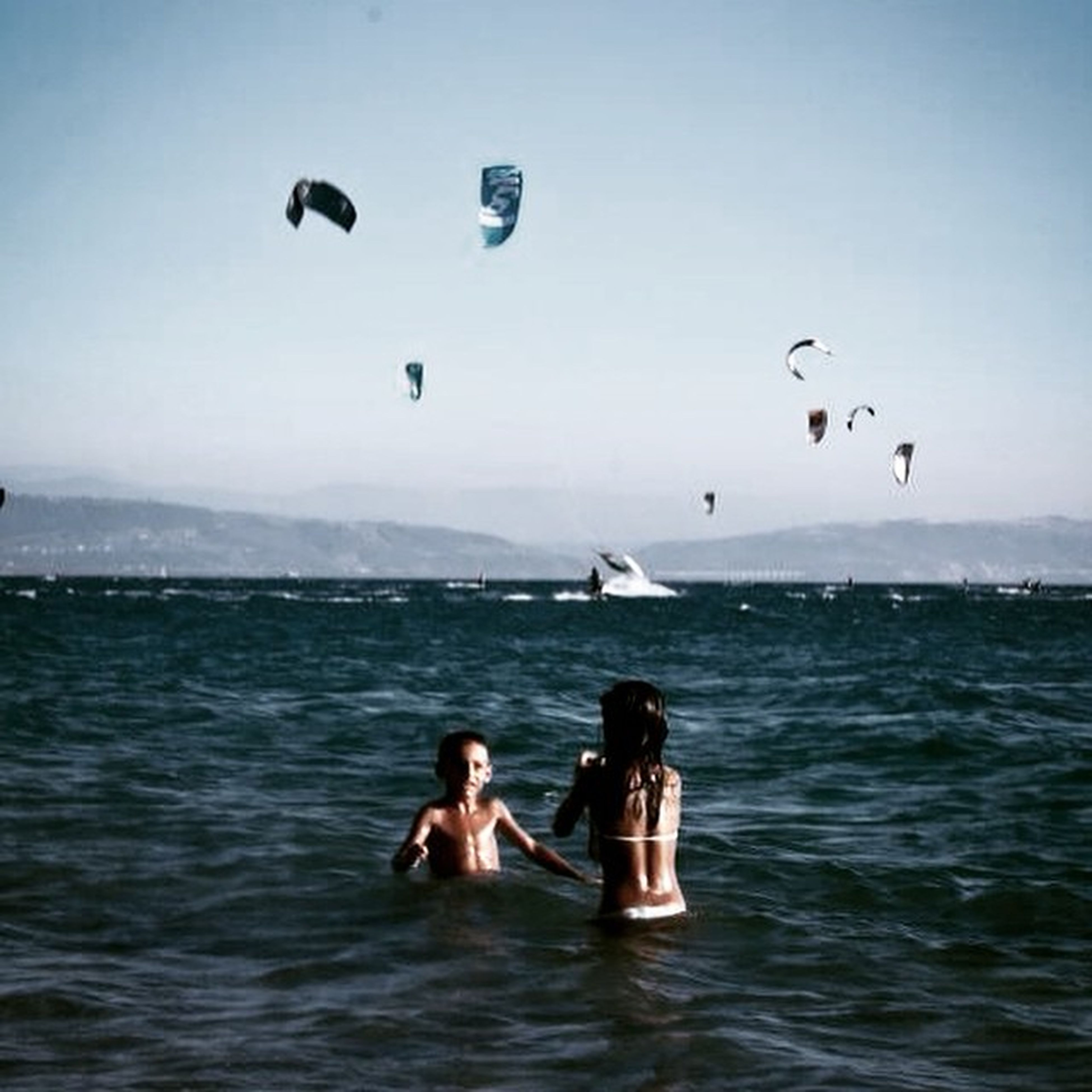 leisure activity, water, sea, lifestyles, waterfront, mid-air, vacations, adventure, enjoyment, fun, flying, men, extreme sports, sport, swimming, sky, scenics, nature