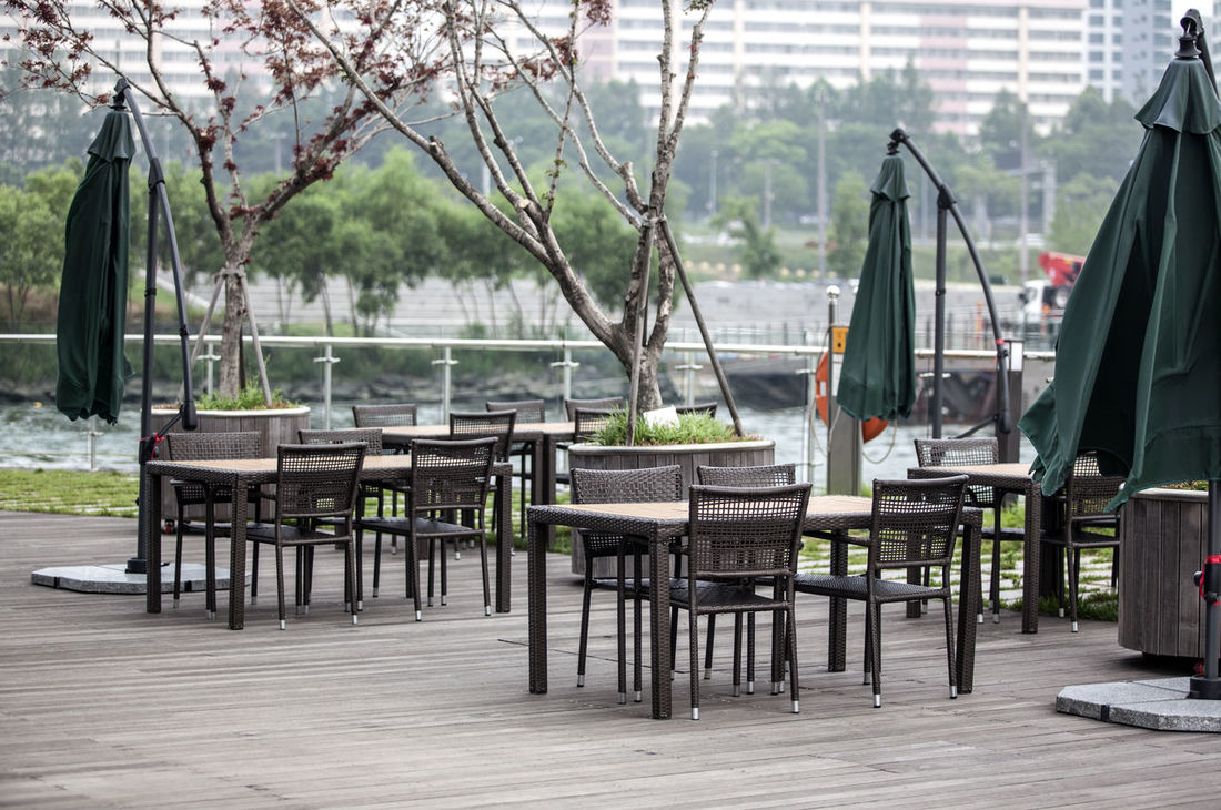 Absence Banpo Hangang Park Beauty In Nature Boat Chair Day Empty Group Of Objects Growth Hangang Idyllic Nature No People Outdoor Cafe Outdoors Parasol Scenics Seat Sky Tables And Chairs Tranquil Scene Tranquility Travel Destinations Tree Water