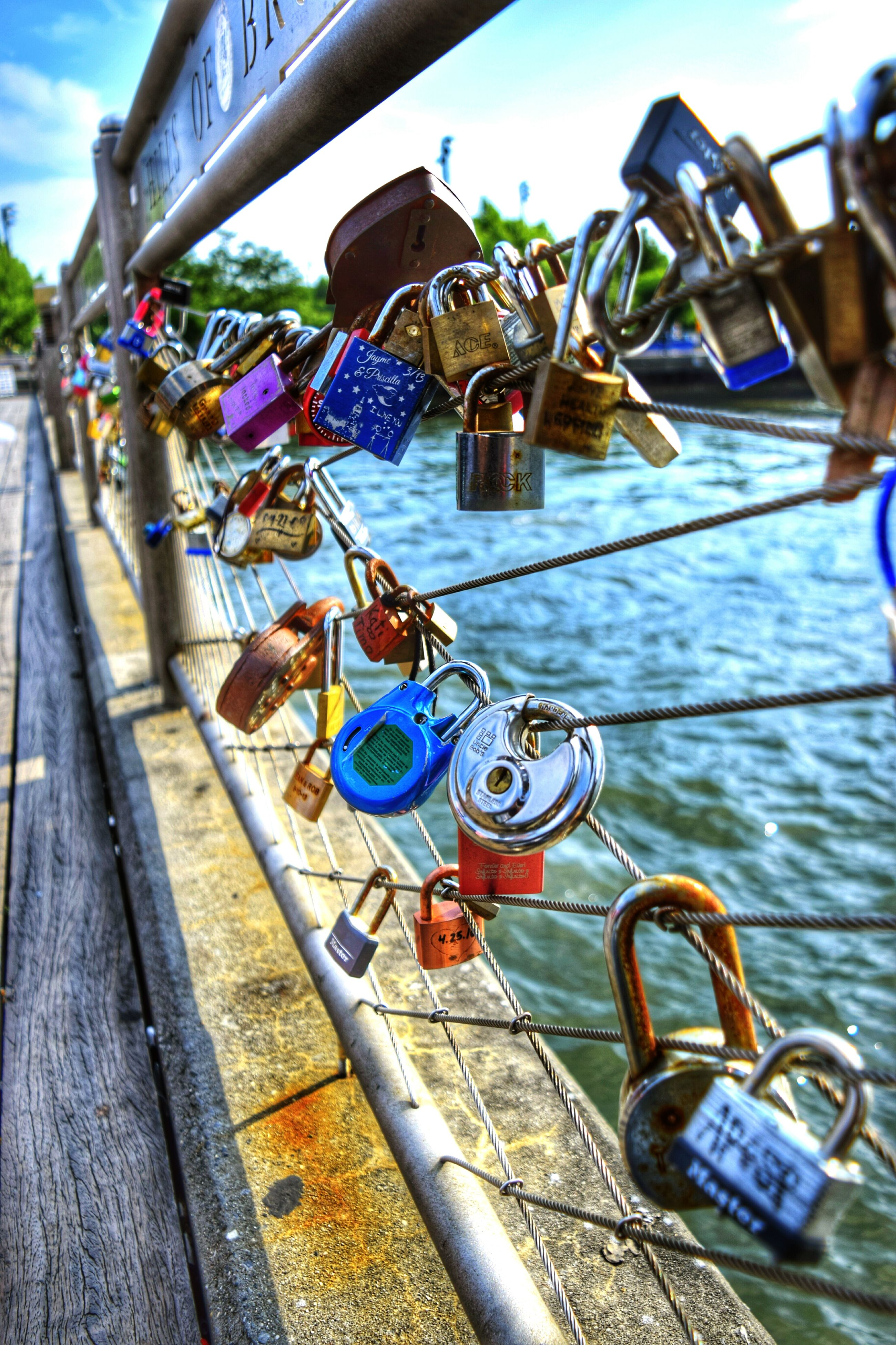 close-up, railing, river, sailboat, water, day, riverbank, marina, focus on foreground, footpath, multi colored, sea, canal, promenade, no people, diminishing perspective, harbor