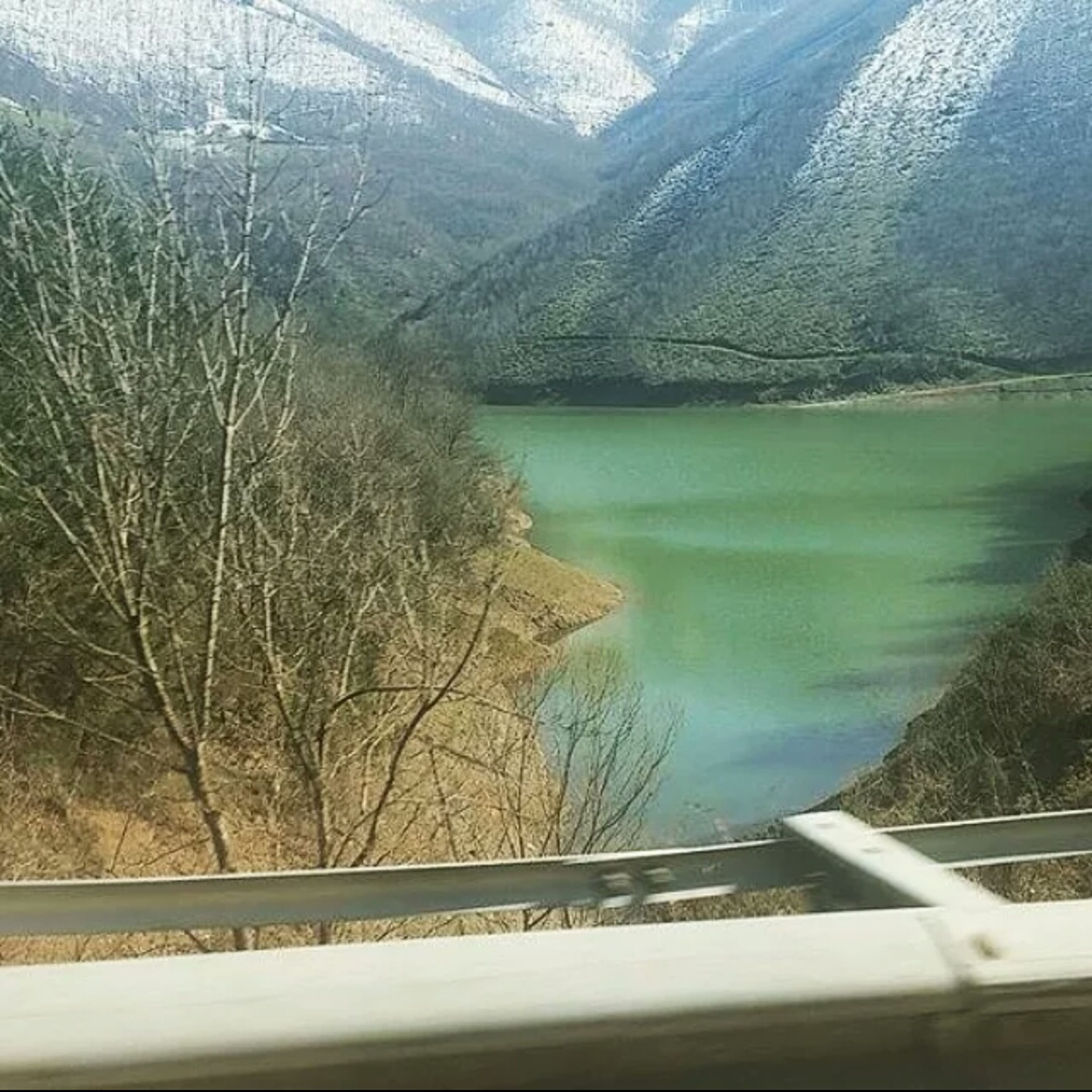 transportation, water, vehicle interior, mode of transport, tree, transparent, glass - material, nature, scenics, window, sky, beauty in nature, river, tranquility, tranquil scene, road, day, travel, high angle view, landscape