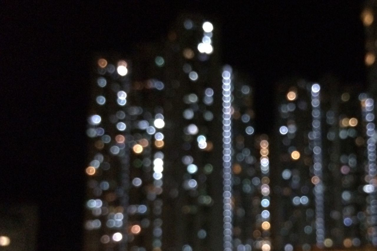 night, illuminated, defocused, focus on foreground, no people, black background, architecture, indoors, close-up