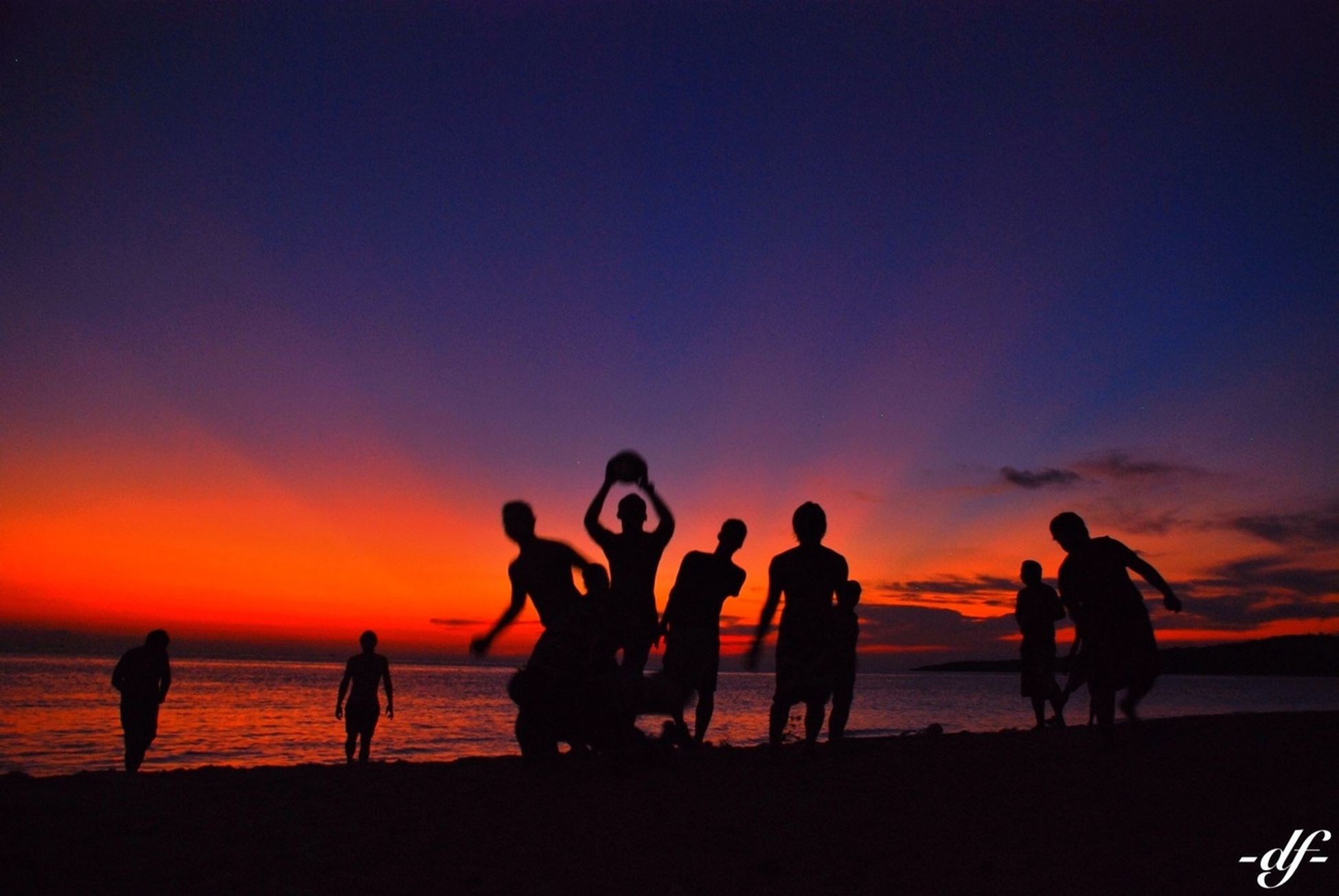 sunset, orange color, leisure activity, lifestyles, sea, beach, silhouette, togetherness, enjoyment, men, sky, horizon over water, fun, vacations, shore, water, friendship, person