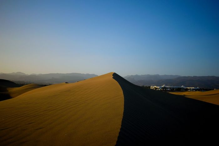 Arid Climate Beauty In Nature Clear Sky Day Desert Landscape Mountain Nature No People Outdoors Sand Dune Scenics Sky Tranquil Scene