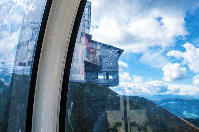 View out of the cable car Abondoned Alpes Architecture Building Building Exterior Built Structure Cable Car Cloud Cloud - Sky Dolomites Dolomites, Italy Glass - Material Kronplatz Mirror Reflection Mountain No People Outdoors Sky Sky And Clouds South Tyrol Südtirol Transparent View Window Window View