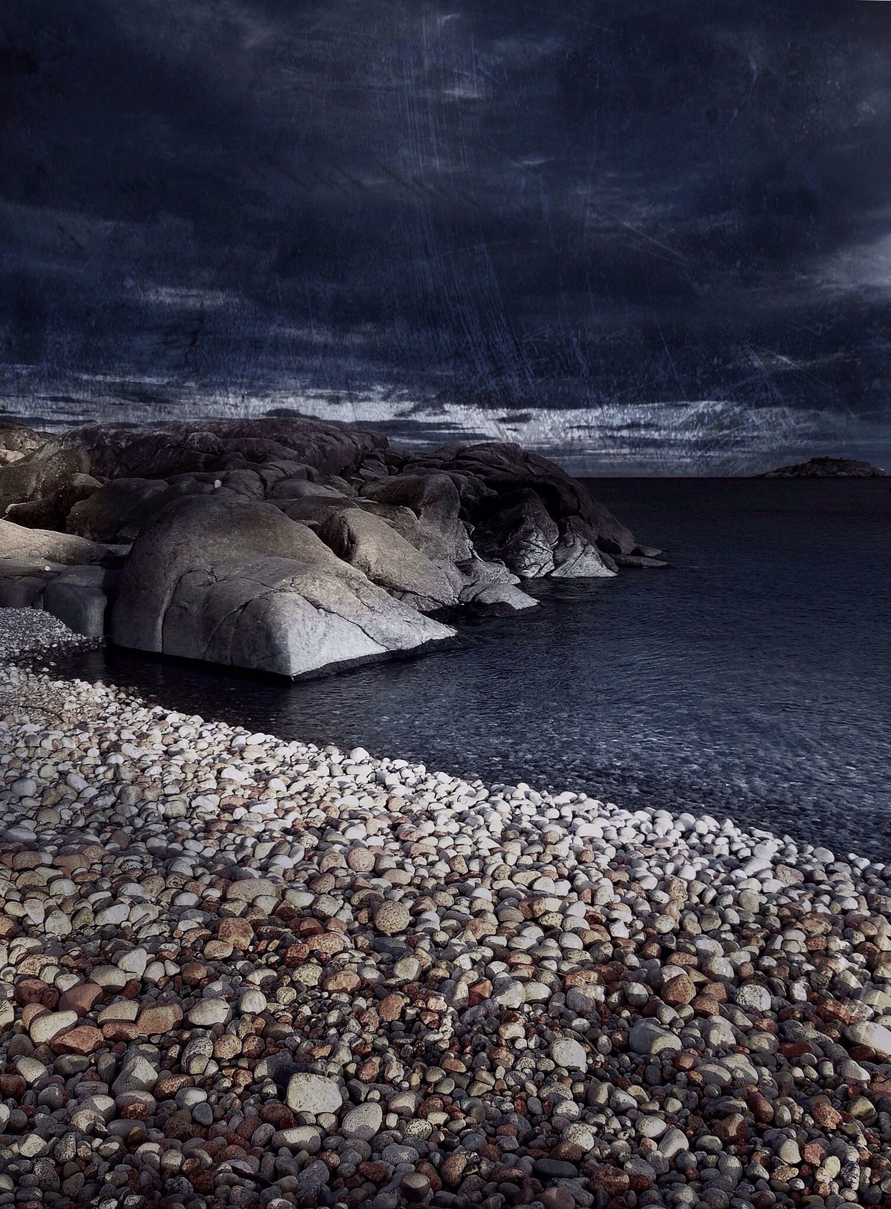 water, sky, sea, tranquility, beach, tranquil scene, scenics, cloud - sky, nature, stone - object, beauty in nature, shore, rock - object, pebble, horizon over water, cloudy, stone, weather, idyllic, surface level