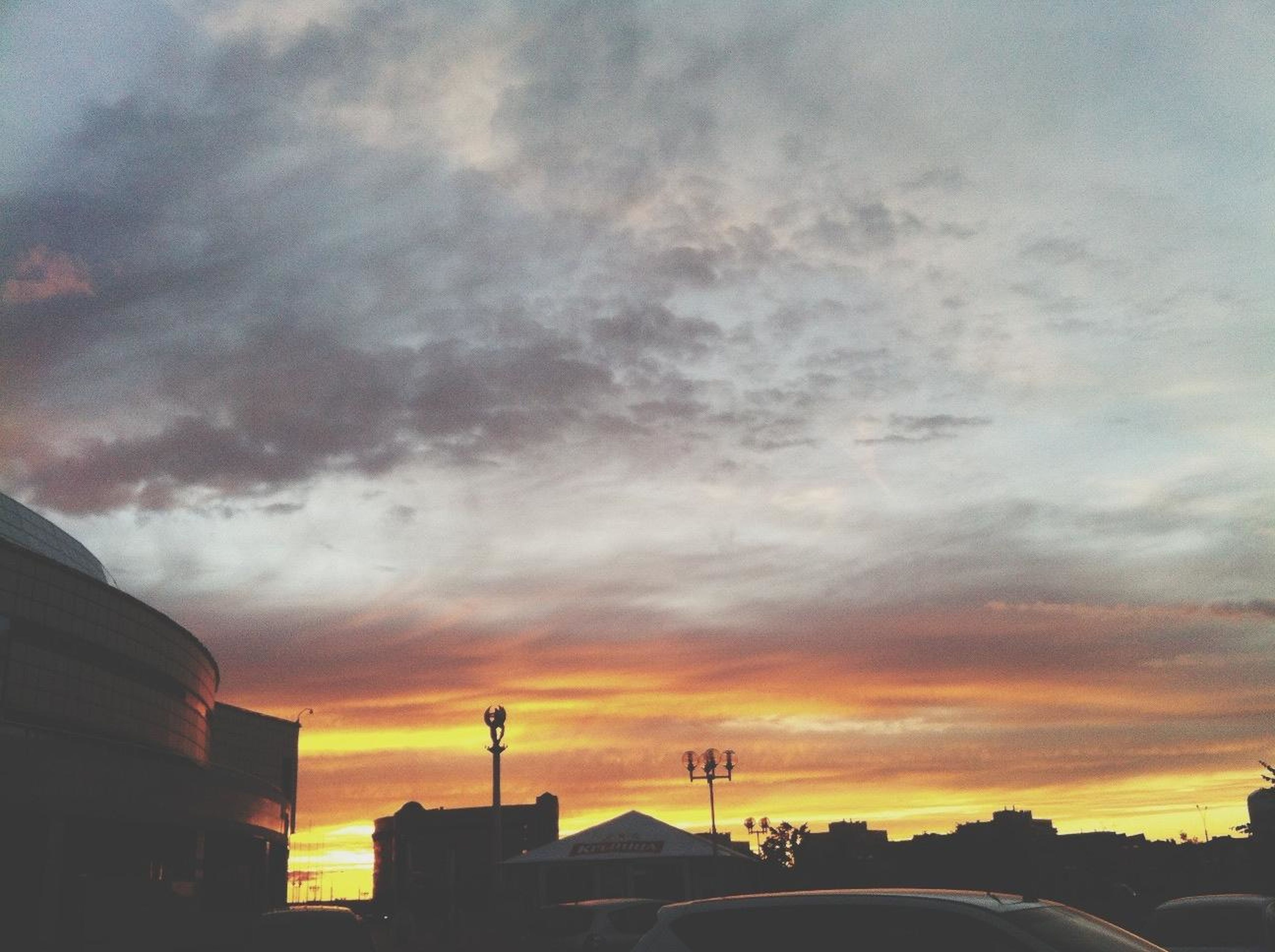 sunset, sky, silhouette, cloud - sky, building exterior, built structure, architecture, low angle view, cloudy, orange color, dramatic sky, cloud, overcast, weather, dusk, beauty in nature, outdoors, nature, house, building