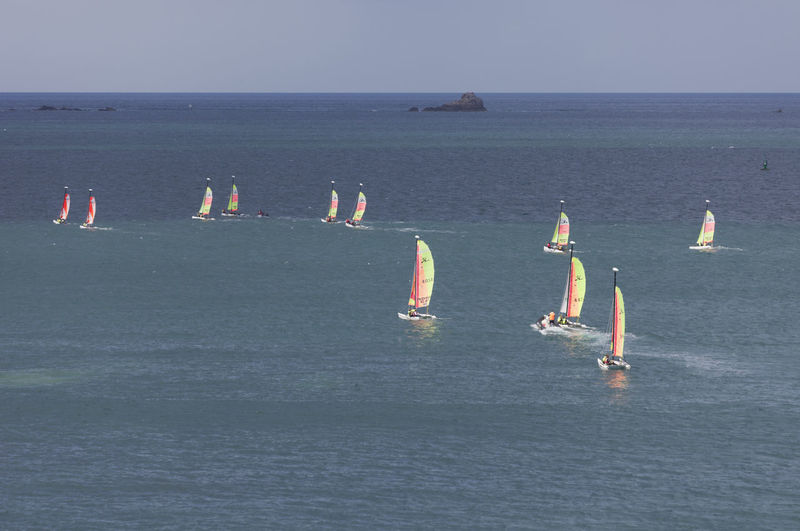 Catamaran sailing on the coast of Saint-Malo, France Aquatic Sport Atlantic Ocean Catamaran Challenge Competition Cruising France Group Of Objects High Angle View Hobie Cat Horizon Over Water Lifestyles People Regatta Sailboat Sailing Sailing Boat Sailing School Saint-Malo Sea Skill  Vacations Water Water Sports Yachting