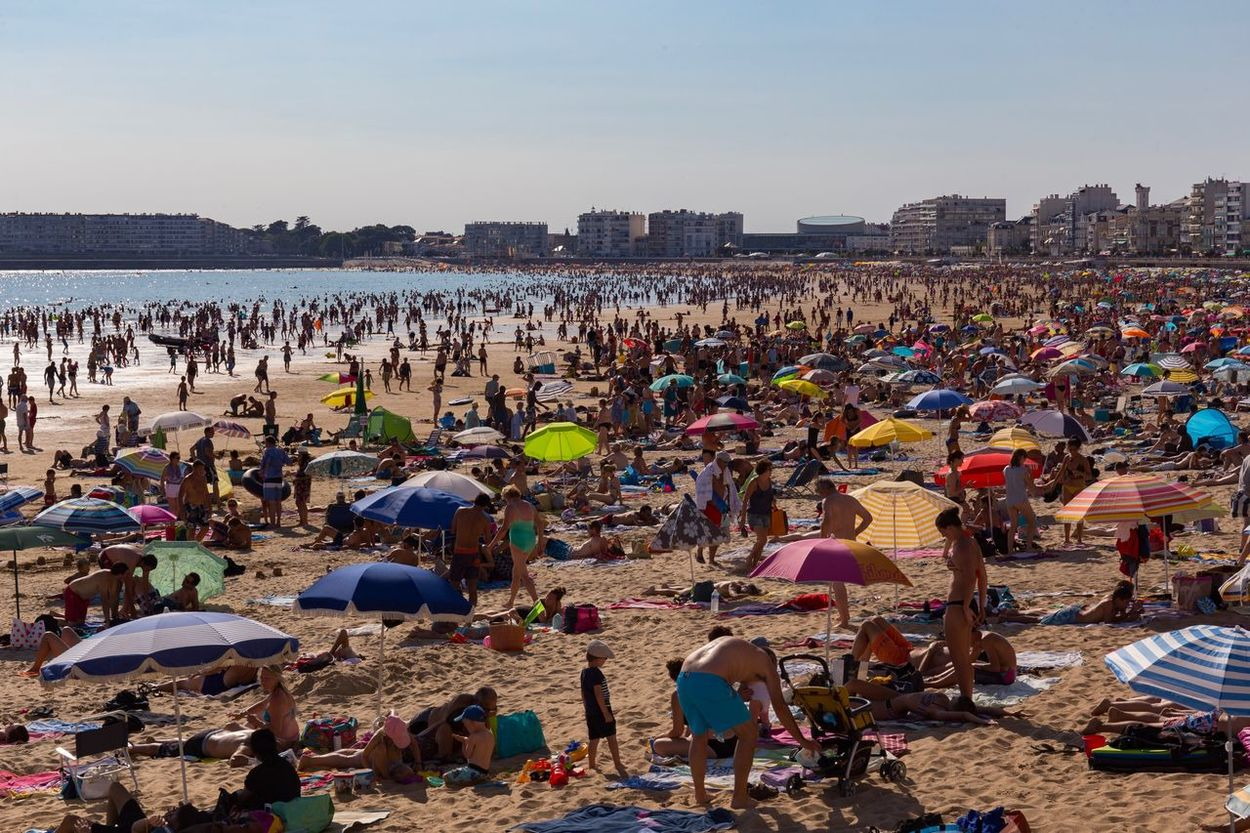 Large Group Of People Beach Sea Sand Crowd Real People Outdoors Clear Sky Leisure Activity Water Day Men Sky Architecture Nature Full Beach Many People Many Colors Wimmelbild