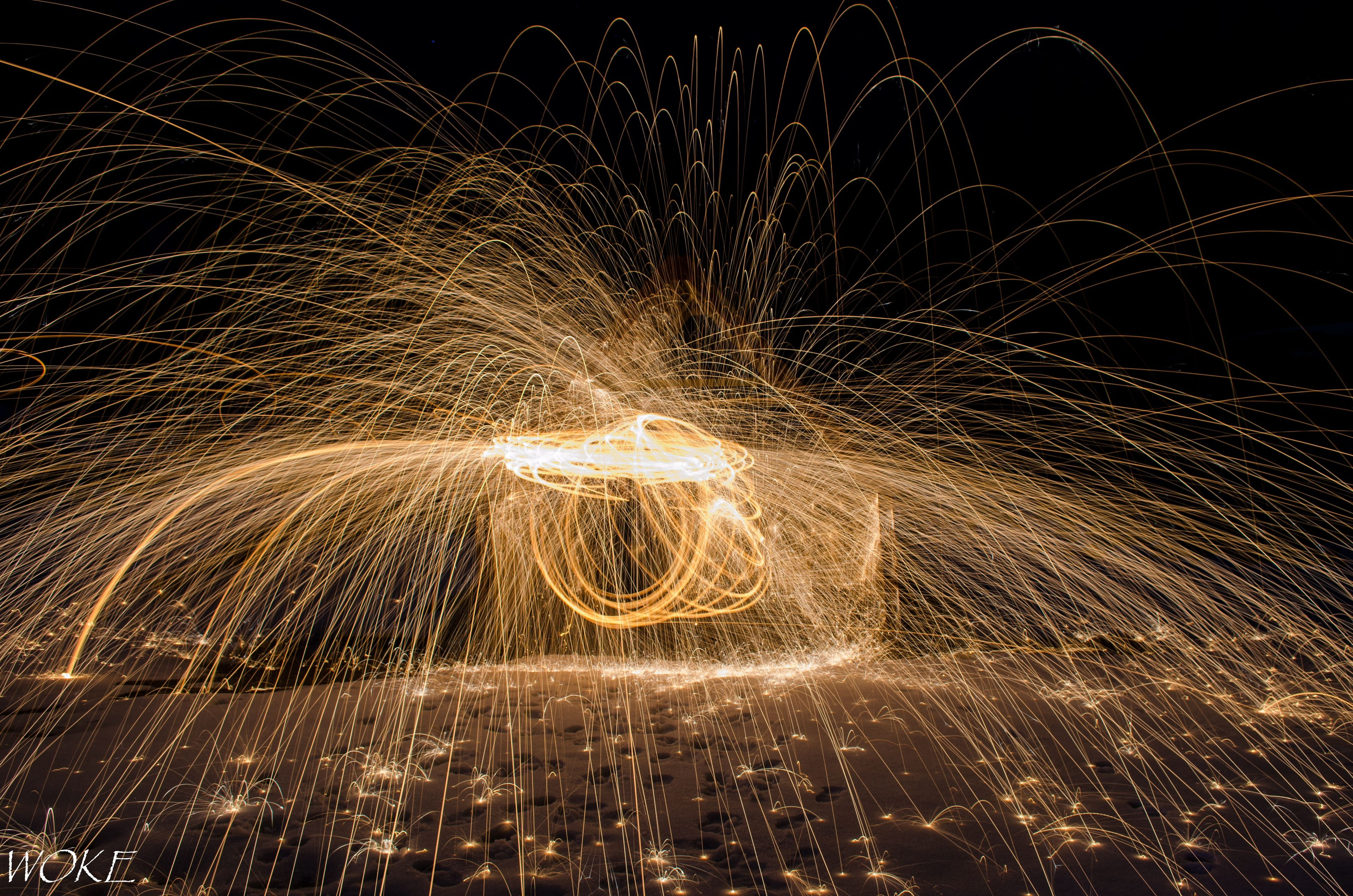 motion, night, long exposure, heat - temperature, blurred motion, sparks, illuminated, burning, close-up, no people, flame, outdoors, speed, wire wool, firework - man made object