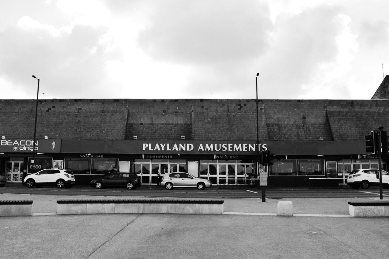 Playland | Taking Photos Showcase March EyeEm Gallery Shootermag Eye4photography  Arcade Amusementpark Road Car Blackandwhite Black And White Sky Sky And Clouds Monochrome Light And Shadow Exploring Streetphotography Urban Urban Geometry Urban Landscape Q