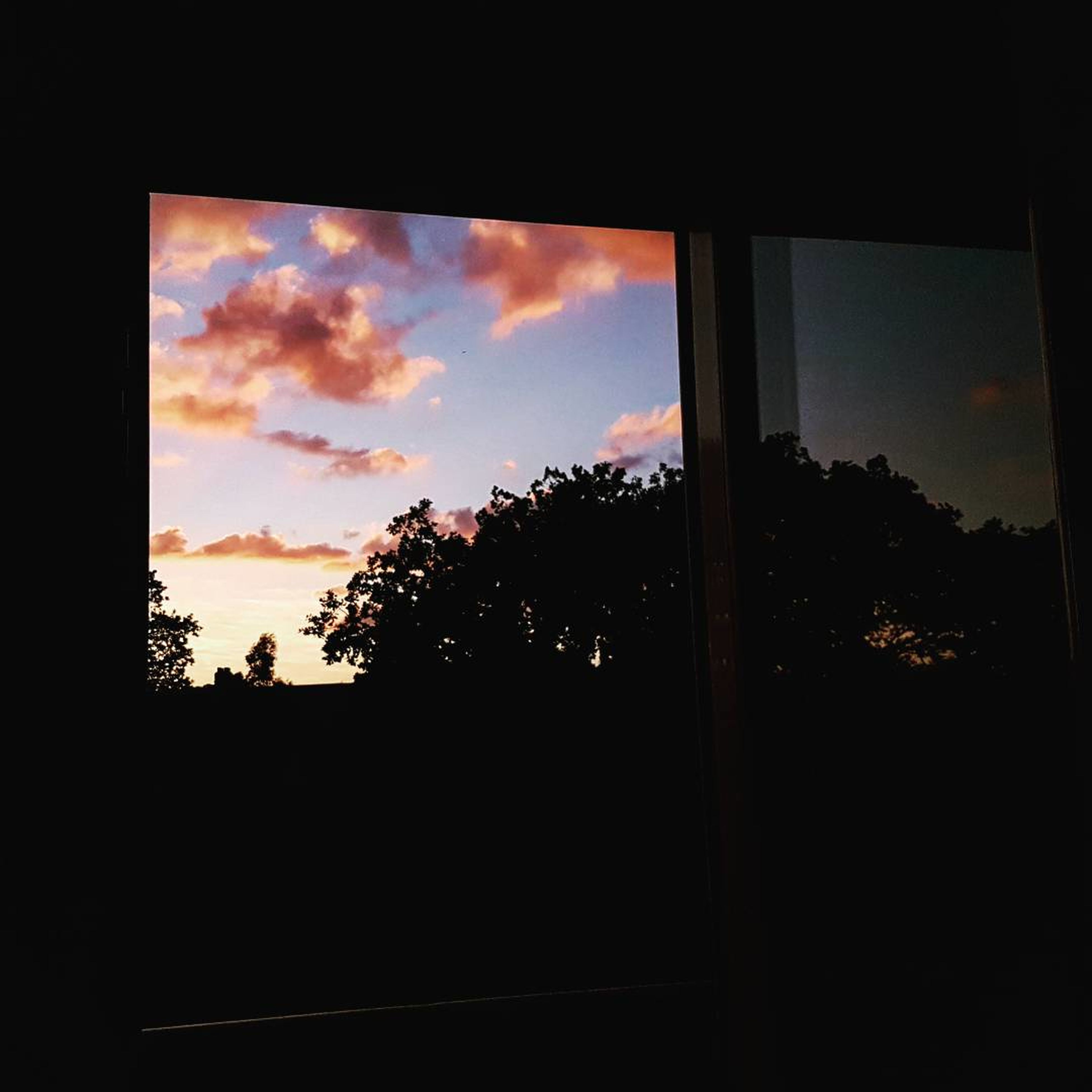 window, tree, sky, silhouette, sunset, cloud - sky, tranquil scene, nature, indoors, scenics, no people, day, beauty in nature, landscape, close-up