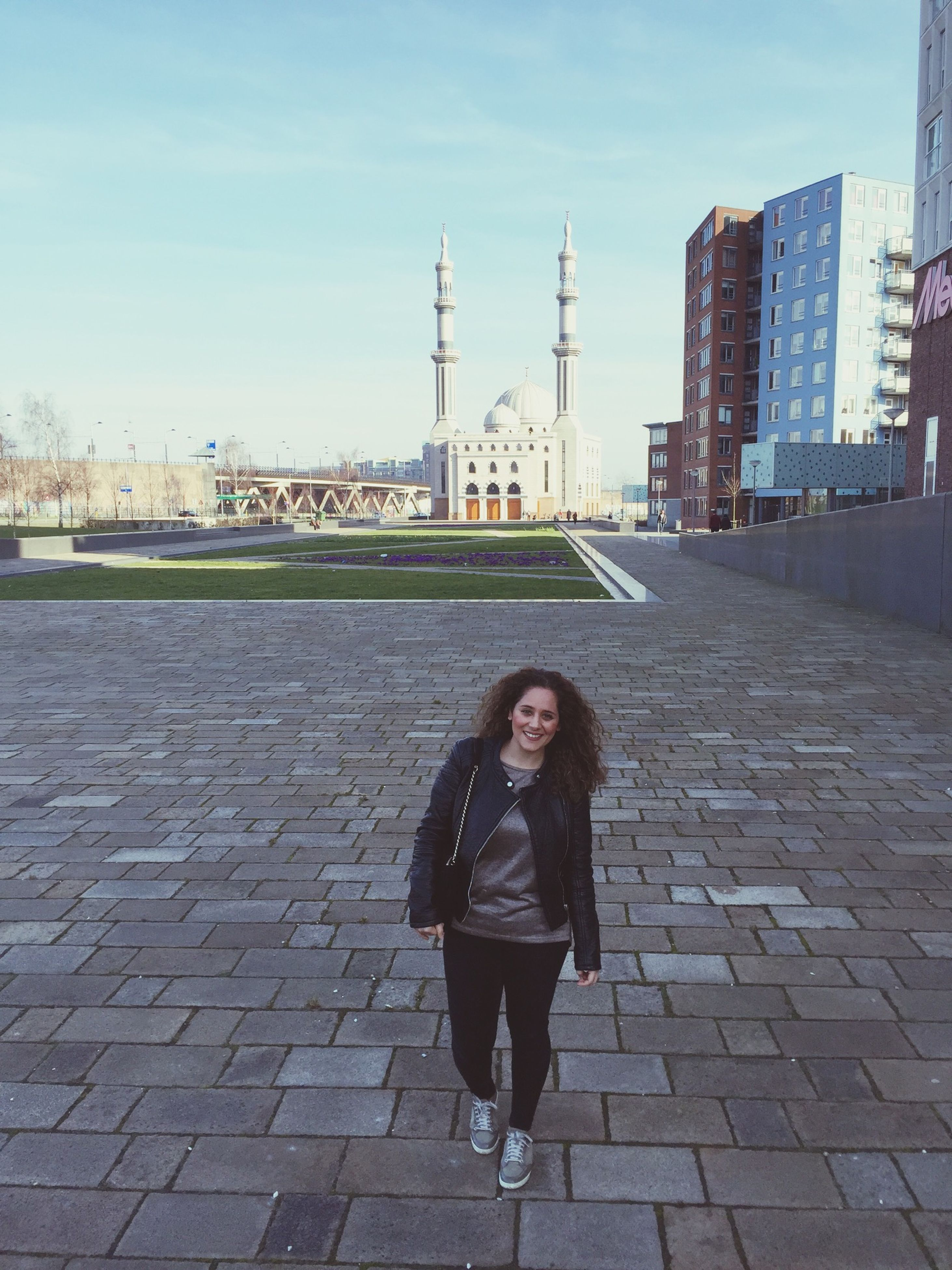 architecture, building exterior, built structure, lifestyles, casual clothing, standing, leisure activity, young adult, full length, sky, city, person, front view, young women, rear view, outdoors, day, looking at camera