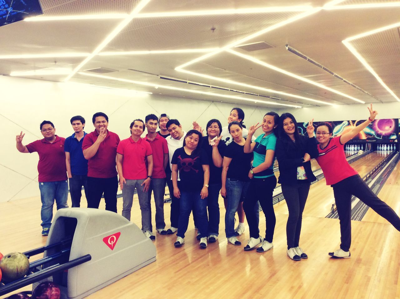 Happy Mid Adult Mid Adult Men Men Full Length Indoors  Standing Adult Student People Large Group Of People Adults Only Togetherness Teamwork Young Adult Only Men Day Bowling Bowling Alley Happy People Event