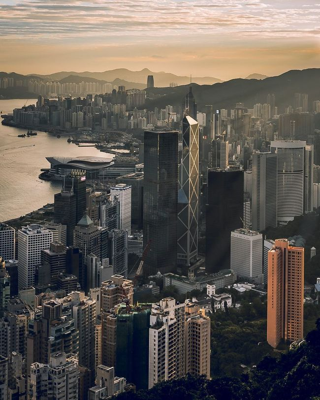 Hong Kong Skyscraper Cityscape Architecture City Building Exterior Urban Skyline Sunset Built Structure Travel Destinations Tower High Angle View Aerial View Modern Outdoors Downtown District Development Growth Scenics