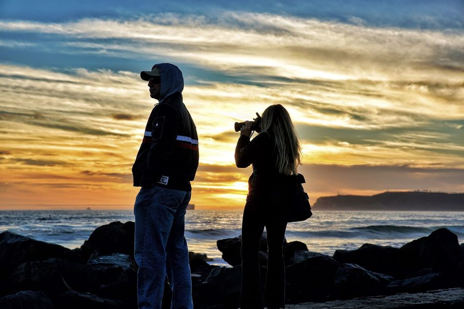 """San Diego""""""""s sunset Sea Two People Sunset Sky Standing Women Lifestyles Cloud - Sky Real People Beauty In Nature Leisure Activity Togetherness Nature Beach Outdoors Photographer Adult People Day Canon 24-70 Sony A7RII"""