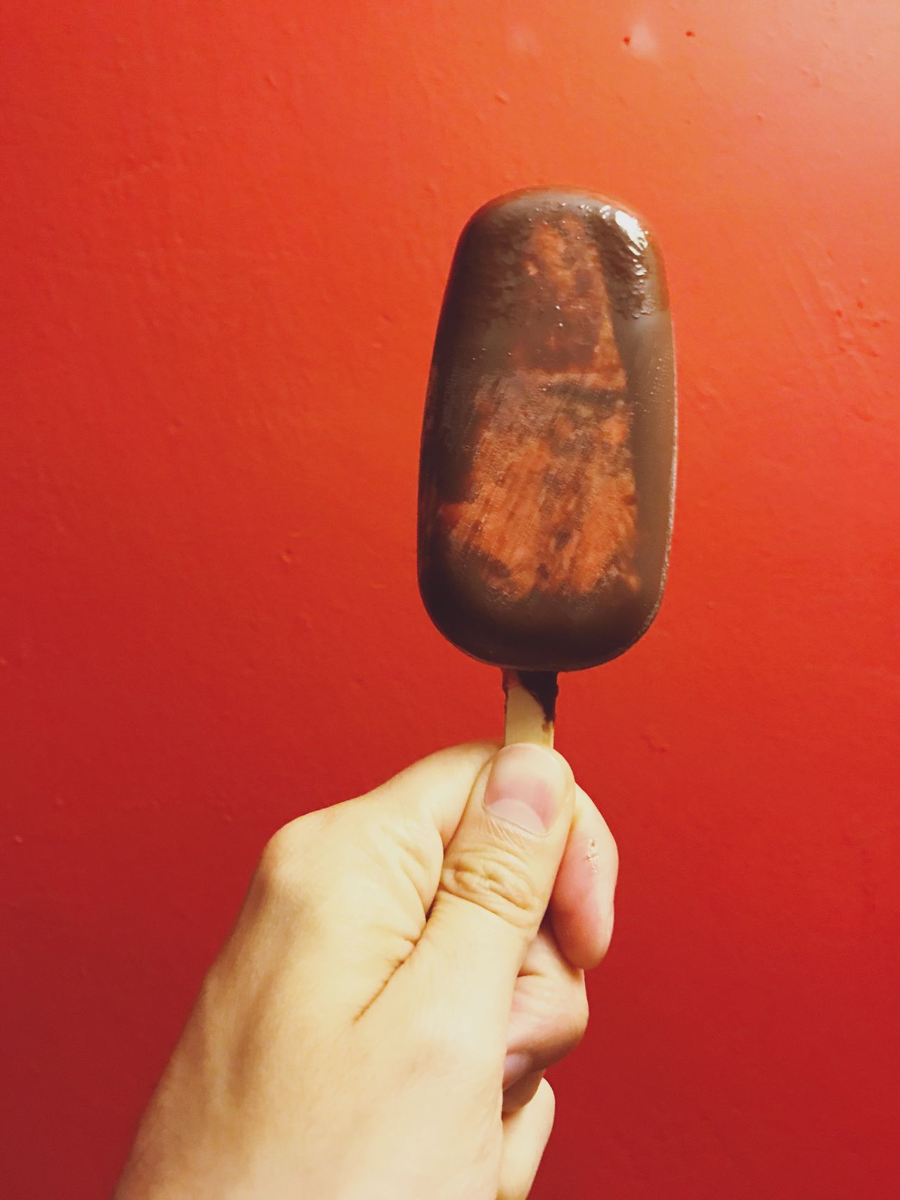 Ice Cream Popsicle Hand Holding Frozen Food Sweet Food Human Hand Human Body Part Human Finger Food And Drink Food Personal Perspective One Person Real People Red Close-up Unhealthy Eating Flavored Ice Freshness Indoors  Ready-to-eat Day