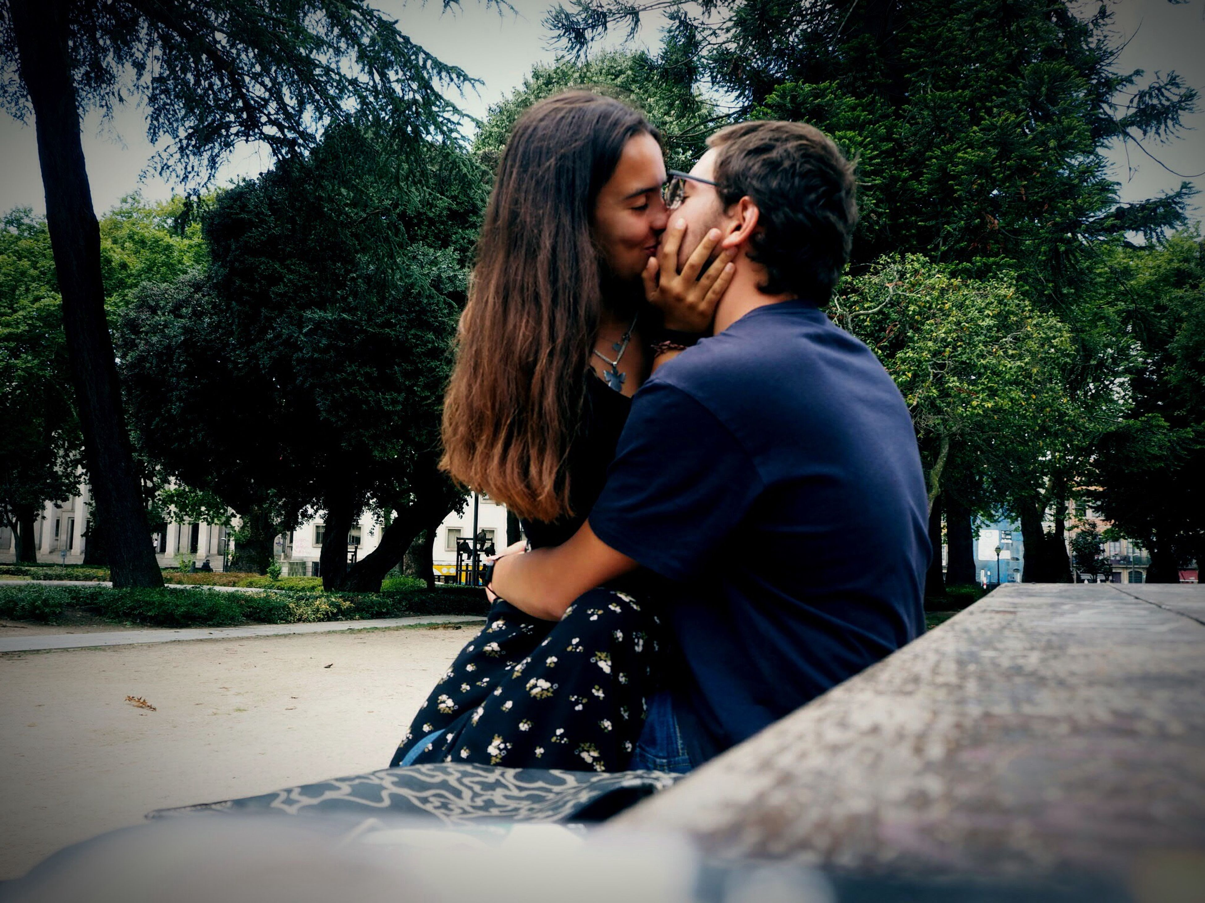love, two people, togetherness, real people, tree, car, bonding, road, embracing, casual clothing, young women, outdoors, leisure activity, lifestyles, happiness, romantic, young adult, smiling, day, nature