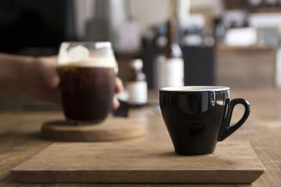 Cafe Close-up Coffee - Drink Coffee Cup Day Drink Drinking Glass Focus On Foreground Food And Drink Freshness Froth Frothy Drink Human Body Part Human Hand Indoors  Latte One Person Refreshment Table Wood - Material
