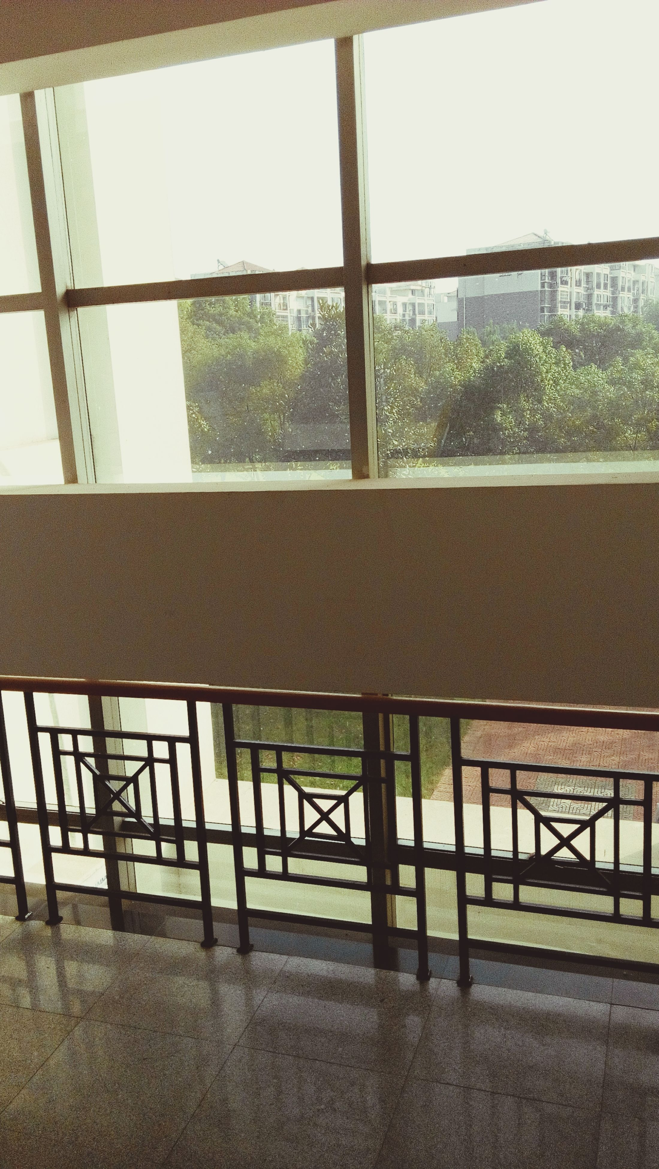 window, architecture, built structure, indoors, glass - material, building exterior, transparent, railing, house, day, sunlight, no people, wall - building feature, door, closed, residential structure, building, balcony, residential building, shadow