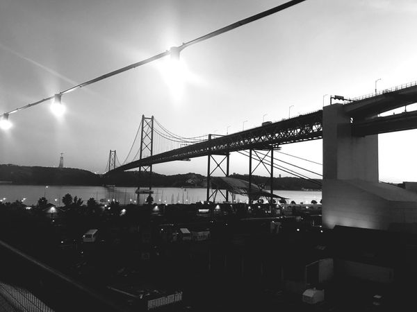 Connection Bridge - Man Made Structure Transportation Built Structure Architecture Sky Outdoors Suspension Bridge Day City Travel Destinations Real People Water Nature Black And White Lisbon