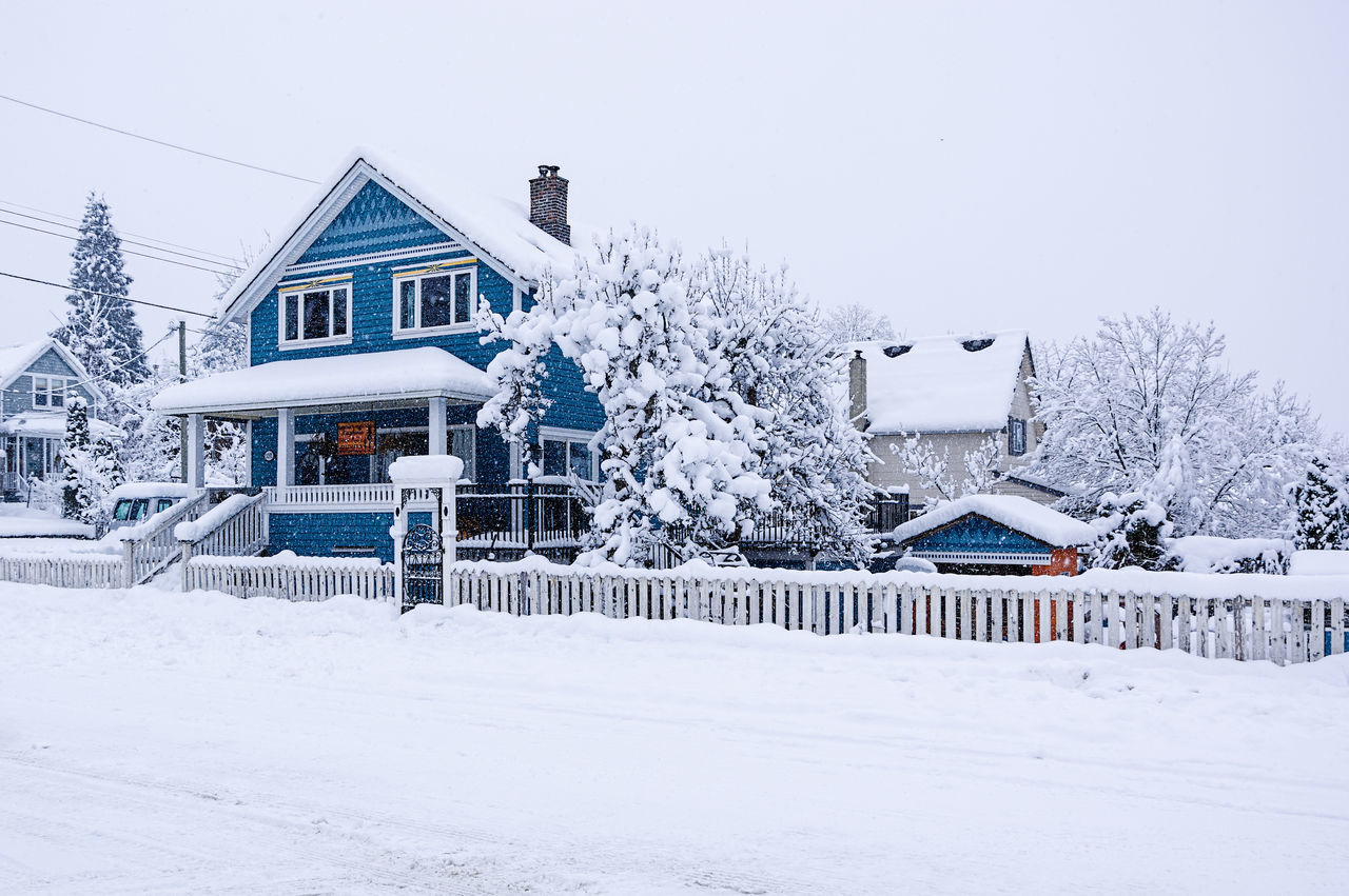 Architecture Building Exterior Built Structure Cold Temperature Day House Housing Development No People Outdoors Residential Building Sky Snow Snowing Tree Winter