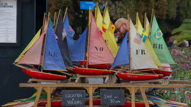 Arts Culture And Entertainment Boats Childhood Colorful Day European  French Group Of Objects In A Row Innocent Jardin Du Luxembourg Multi Colored Outdoors Paris Paris, France  Sailboat Swimming Text