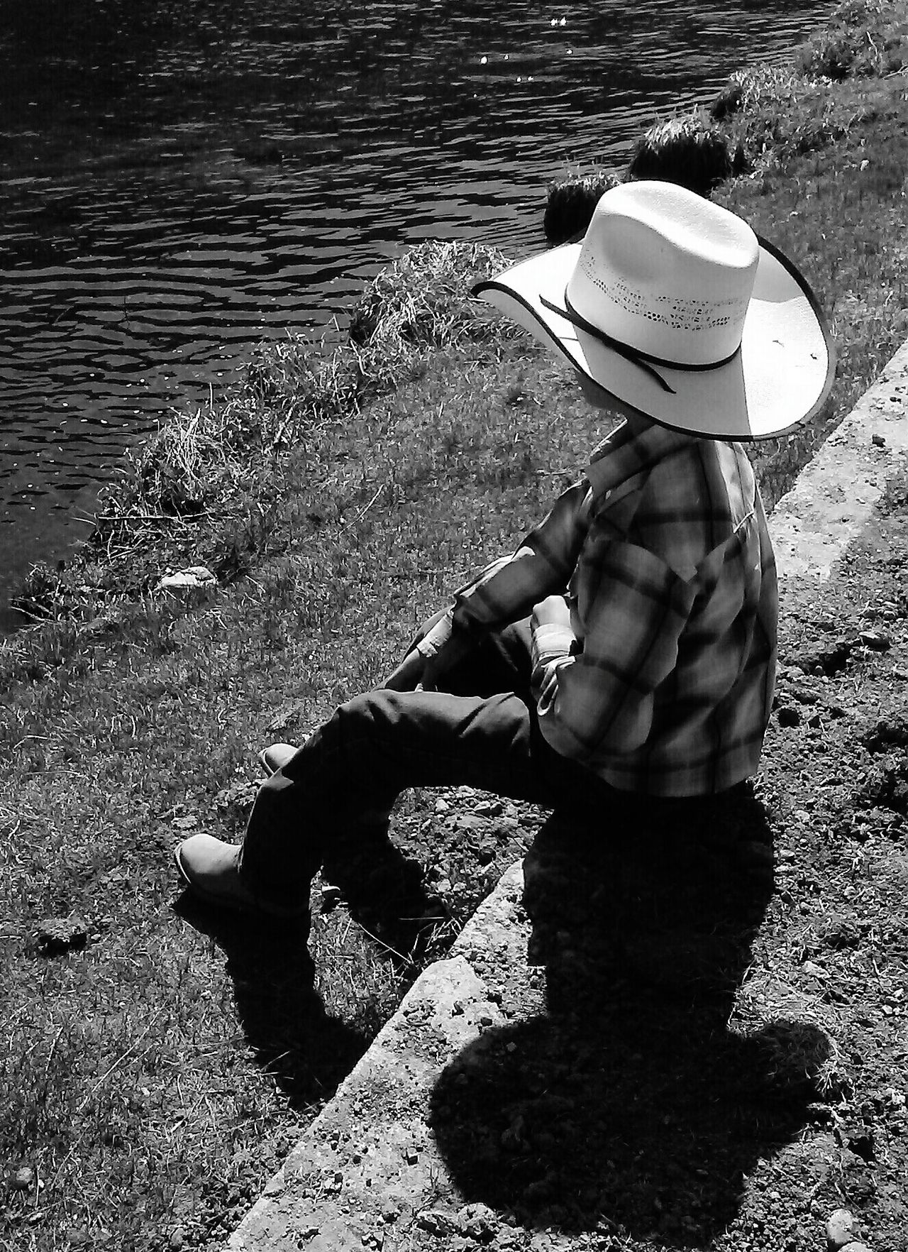 Little Cowboy Hat One Person Straw Hat Sun Hat Sitting Water Outdoors Real People Childhood