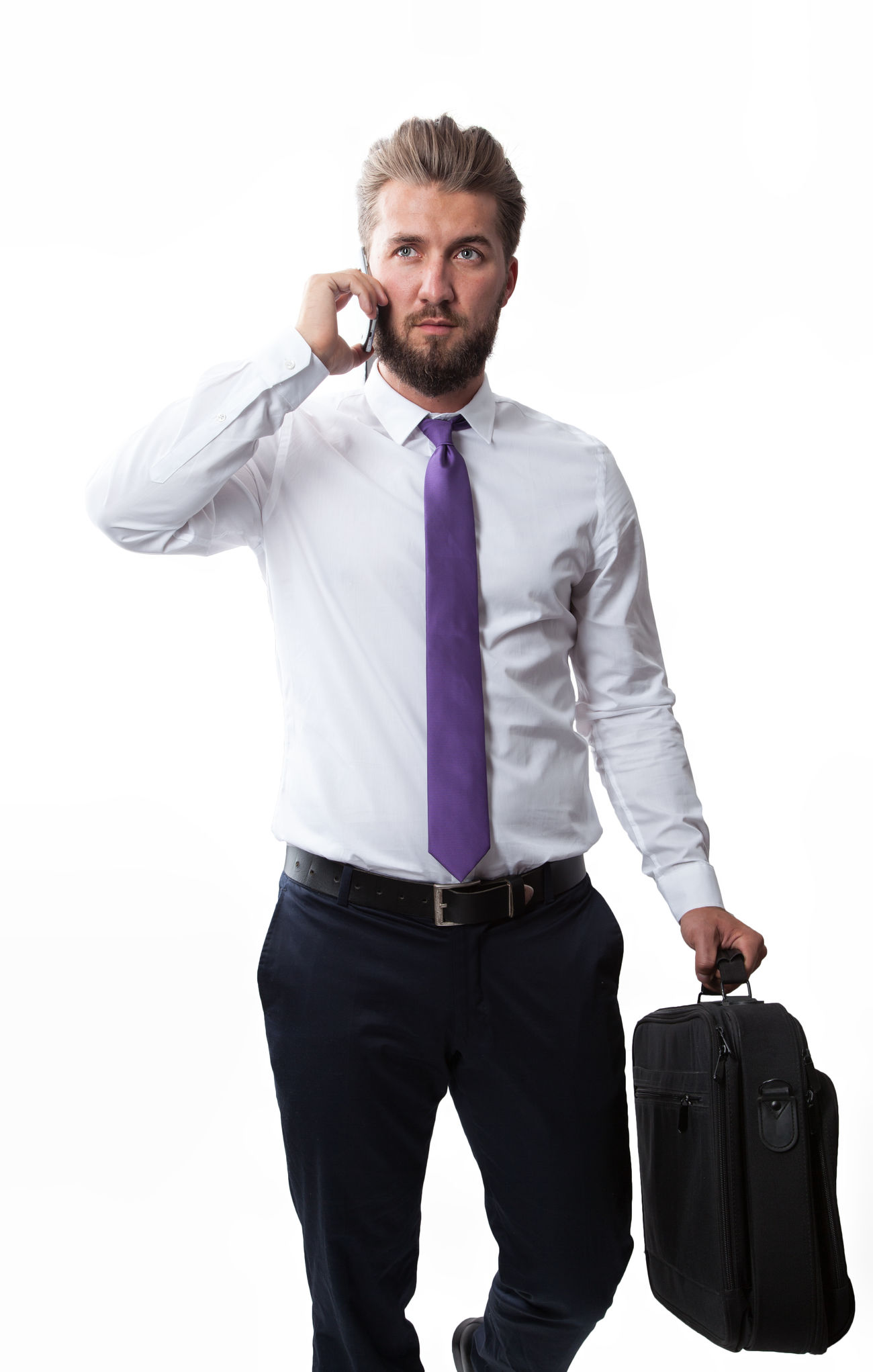 Attractive businessman with a beard is walking and talking on a smart phone Attractive Background Beard Businessman Call Cellphone Fashion Forward Full Length Handbag  Handsome Holding Isolated Model One People Person Smartphone Studio Successful Suit Talking Walk White Worker