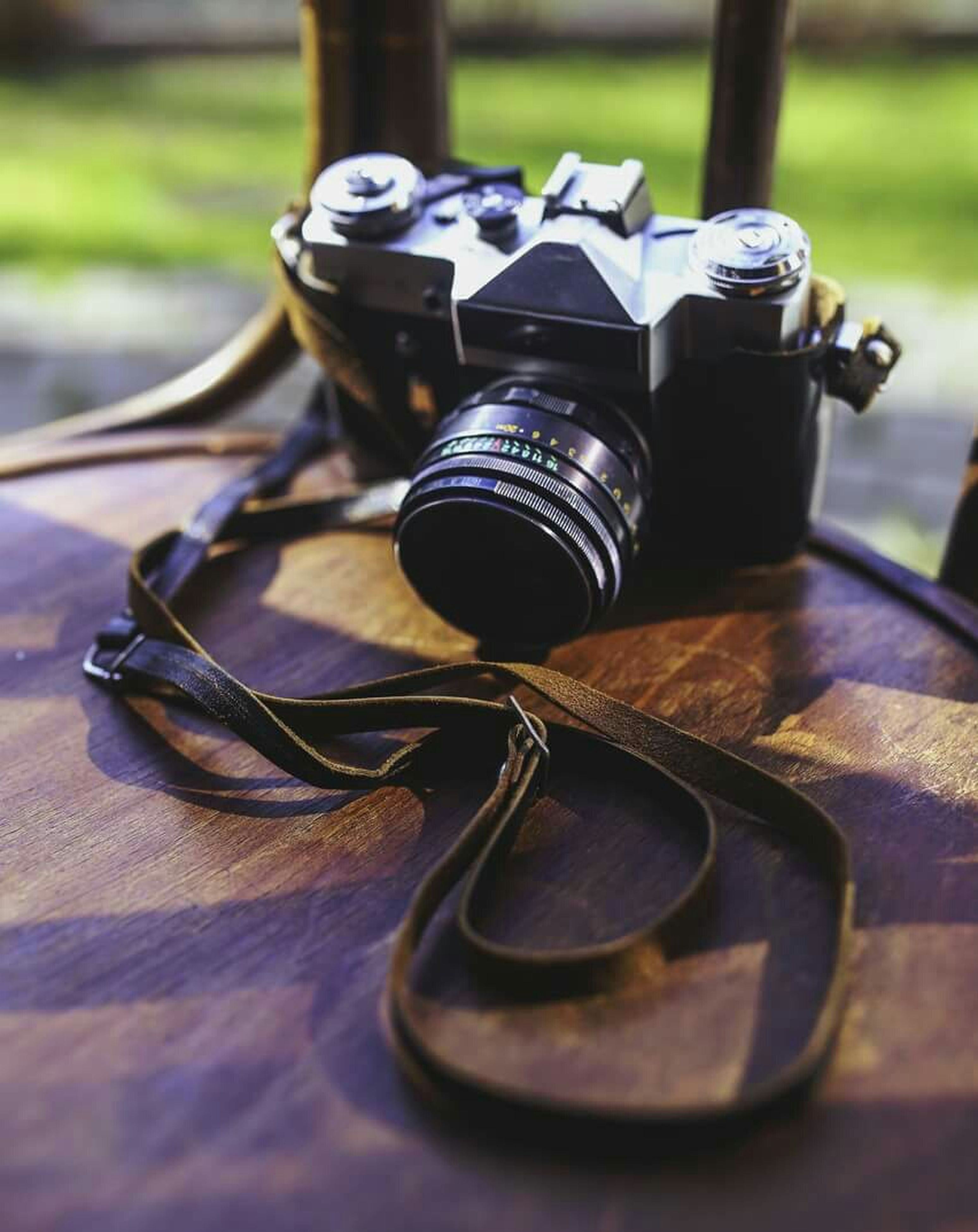 focus on foreground, selective focus, close-up, metal, still life, day, sunlight, technology, equipment, music, no people, outdoors, old-fashioned, part of, table, single object, metallic, man made object, bicycle, surface level