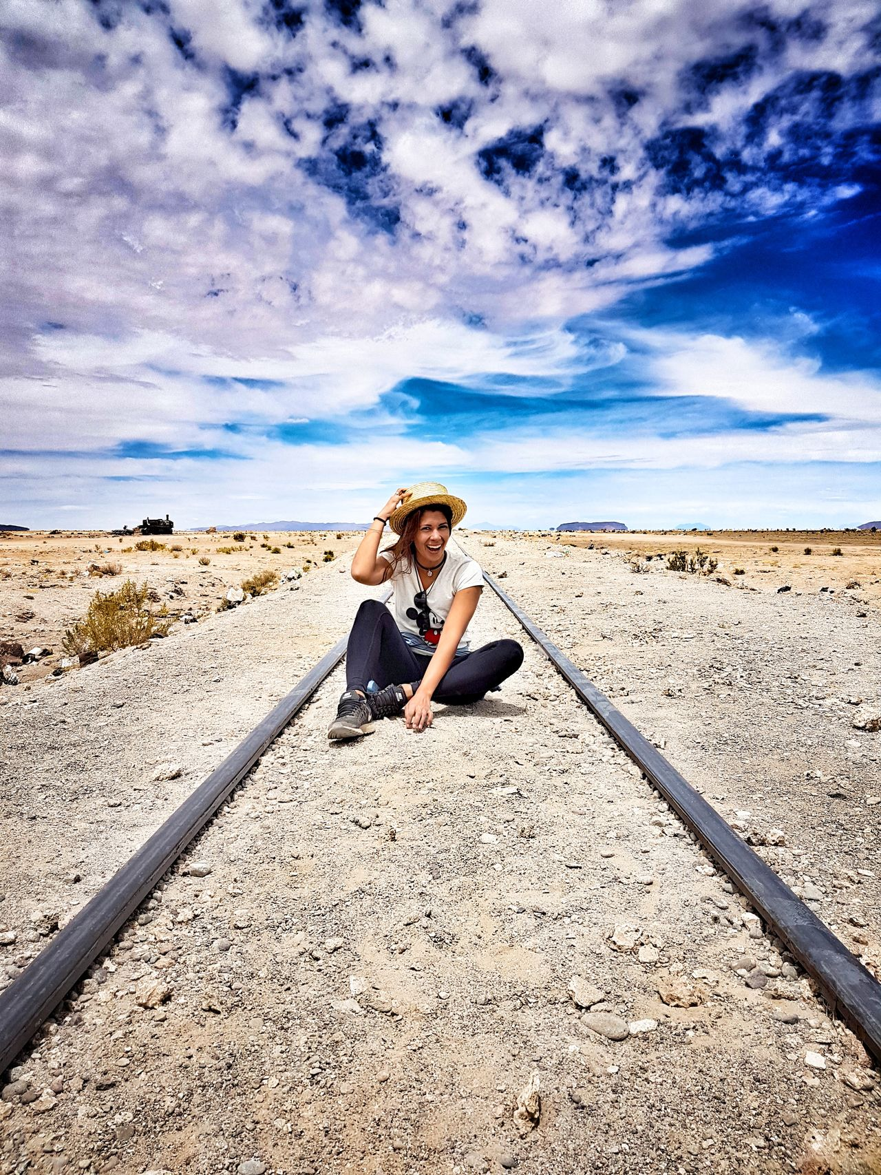 One Person Cloud - Sky Real People Leisure Activity Sky Outdoors Lifestyles Sand Nature Train Tracks Candyfloss Clouds Hat Happy Laughing Landscape Travel Desert Bolivia